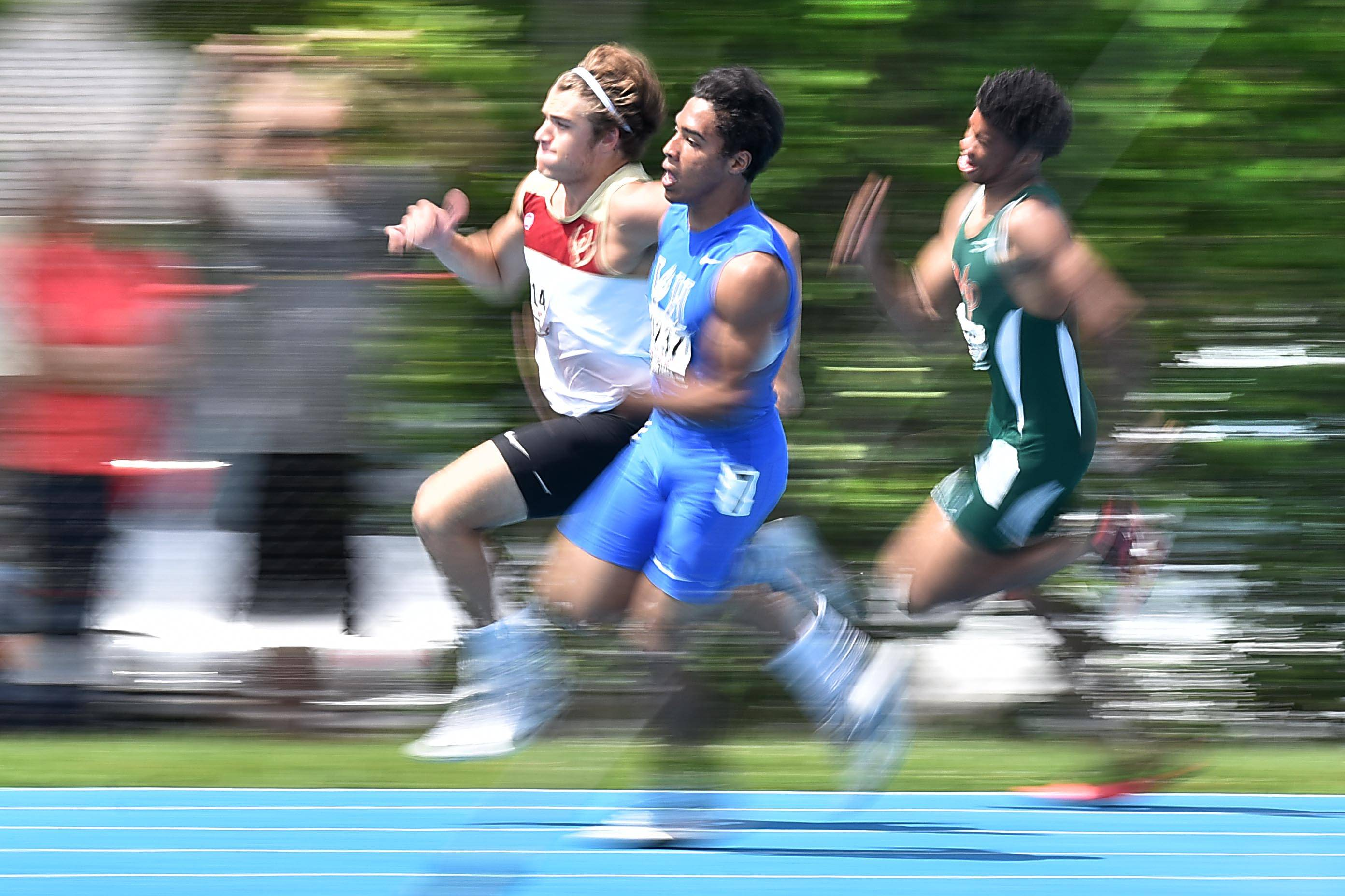 Vernon Hills' Joshua Williams and Montini's Mitch West streak around the corner in the Class 2A 200 meter dash Saturday at the boys track state finals in O'Brien Stadium at Eastern Illinois University in Charleston.