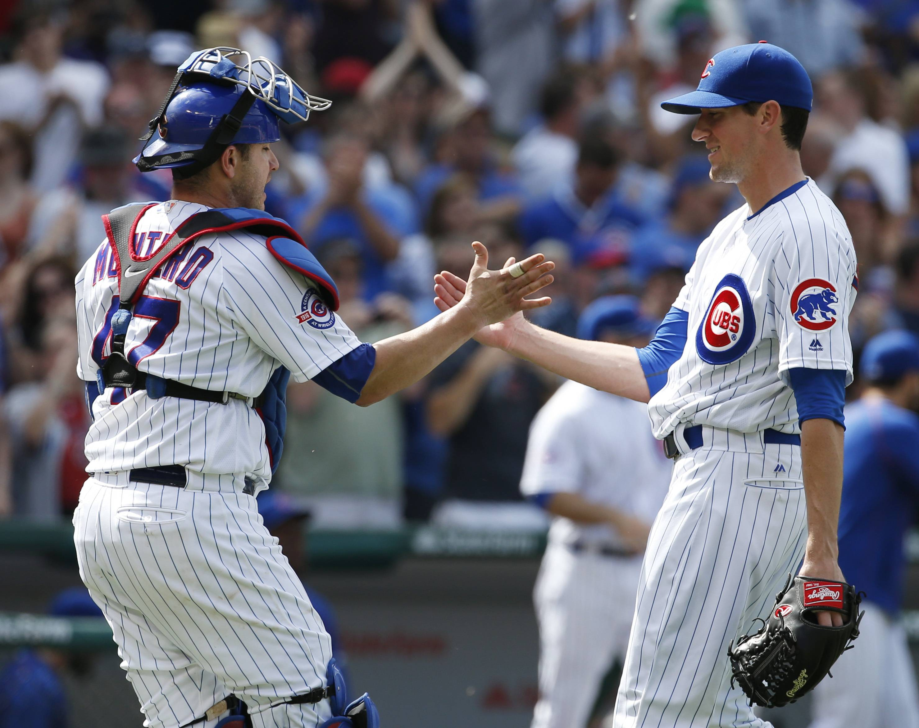 Cubs starter Kyle Hendricks celebrates with catcher Miguel Montero after the Cubs defeated the Philadelphia Phillies 4-1 on Saturday at Wrigley Field.