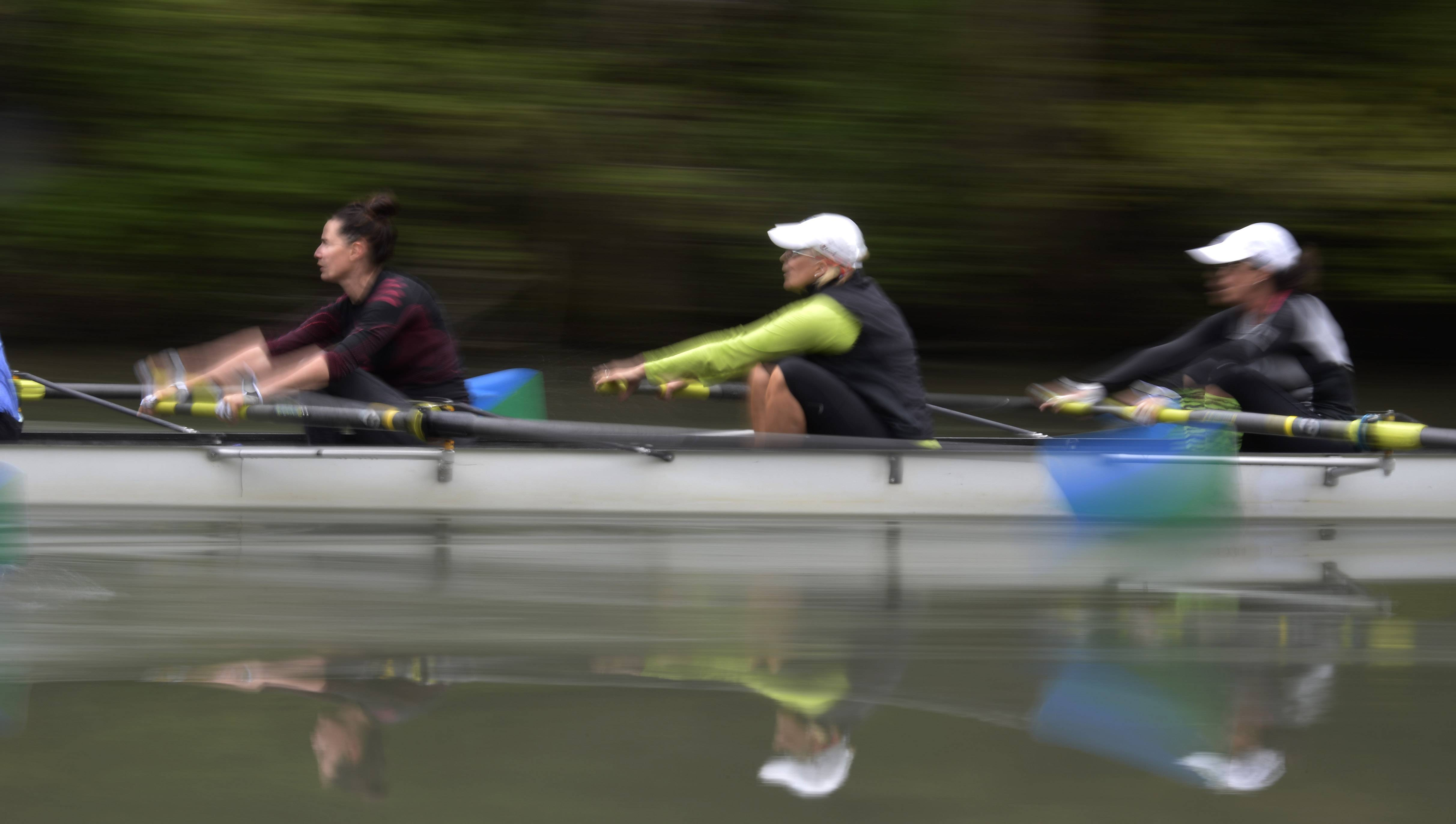 Members of the New Trier Masters rowing club practice on the Chicago River channel in Skokie. The group features women from the ages of 36-73 putting their body, mind and soul into the sport.