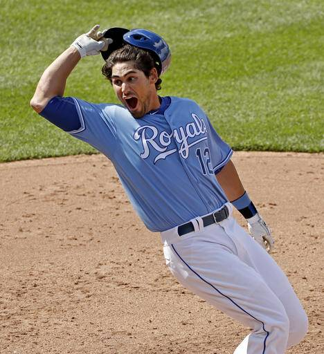 Kansas City Royals' Brett Eibner celebrates after hitting the game-winning single during the ninth inning of a baseball game against the Chicago White Sox on Saturday, May 28, 2016, in Kansas City, Mo. The Royals won 8-7. (AP Photo/Charlie Riedel)