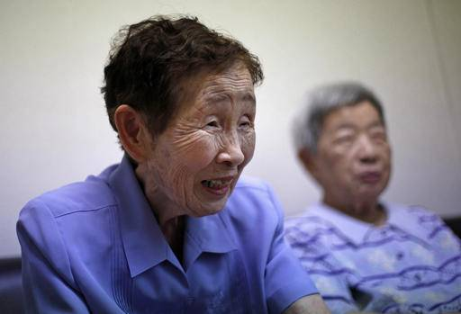 "Atomic bomb survivor Kimie Miyamoto, 89, speaks during an interview at a retirement home she shares with other bomb victims, in Hiroshima, Japan, Saturday, May 28, 2016. A-bomb survivors feel both wonder and doubt after U.S. President Barack Obama visited the Hiroshima Peace Memorial Park on Friday. ""The world paid attention to what happened here, even if just for a while, because someone as important as him came to Hiroshima. So perhaps it could make things a little bit better,"" Miyamoto said of Obama's visit in an interview. ""But you never really know if it will make a difference, because so much depends on what other countries are thinking as well."" At right is another bomb survivor Michiko Kimoto, 87. (AP Photo/Shuji Kajiyama)"