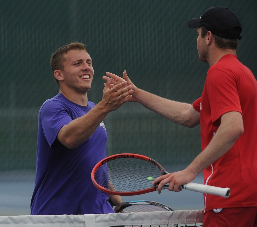 Rolling Meadows senior Mack Galvin congratulates Deerfield's Vuk Budic after his marathon win in a match of previously unbeaten players in the boys tennis state semifinals at Hersey on Saturday. Budic went on to win the singles championship.