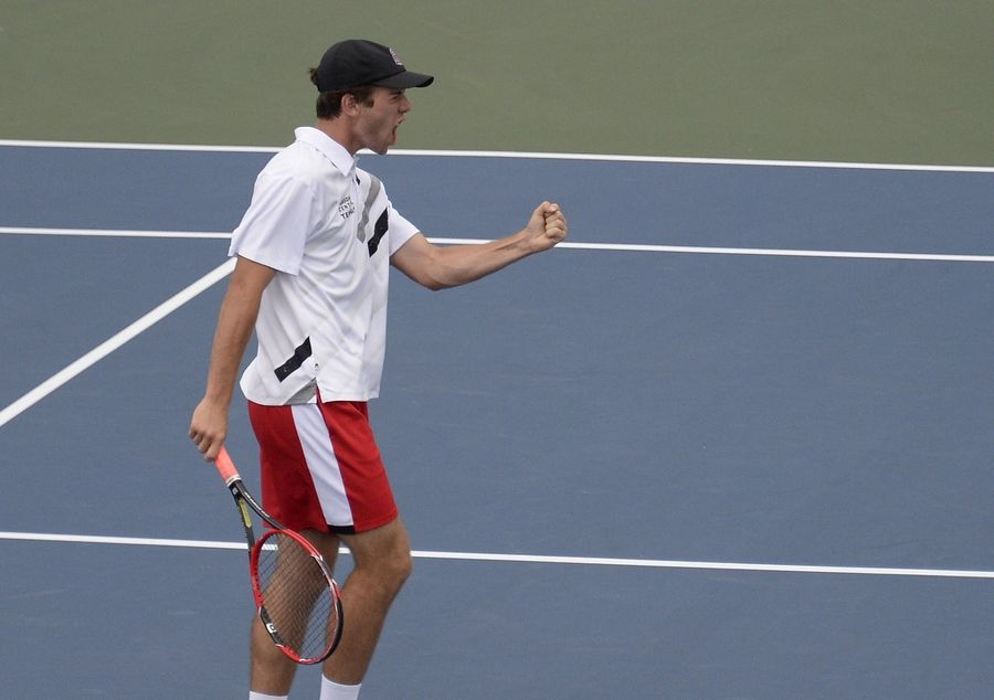 Hinsdale Central's Nick Calzolano celebrates a victory point with teammate Michael Czlonka in the doubles semifinals at Hersey on Saturday.