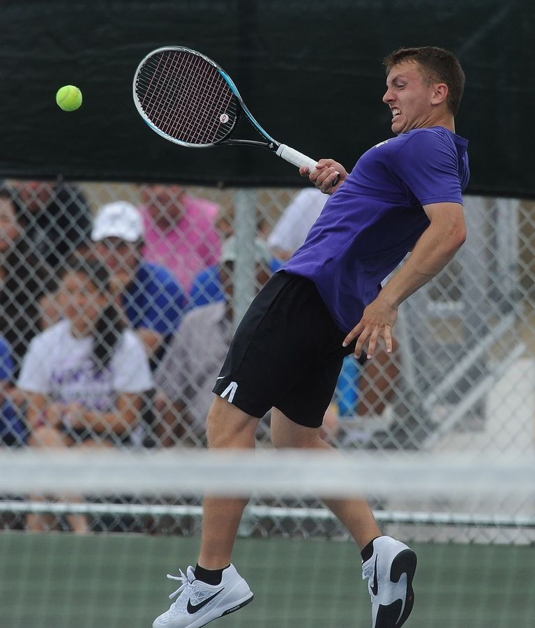 Rolling Meadows' Mack Galvin battles with Deerfield's Vuk Budic during a marathon singles semifinal match at Hersey on Saturday.