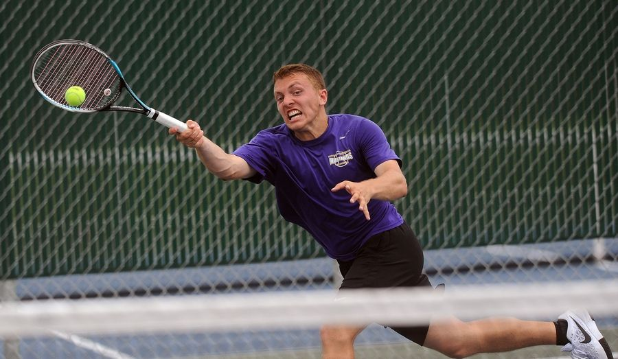 Rolling Meadows' Mack Galvin battles against Deerfield's Vuk Budic during a marathon singles semifinal matchup at Hersey on Saturday.