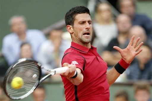 Serbia's Novak Djokovic returns in the third round match of the French Open tennis tournament against Britain's Aljaz Bedene at the Roland Garros stadium in Paris, France, Saturday, May 28, 2016. (AP Photo/Alastair Grant)