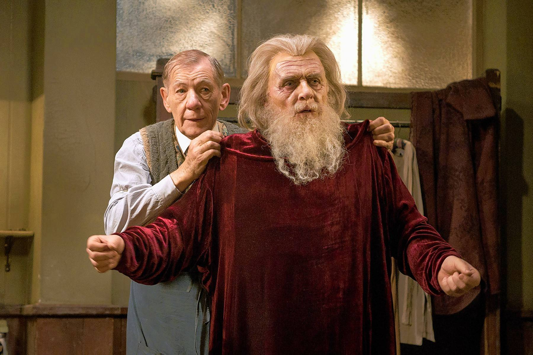 "Norman (Ian McKellen), left, helps Sir (Anthony Hopkins) prepare to star as King Lear in Starz's new TV adaptation of ""The Dresser."""