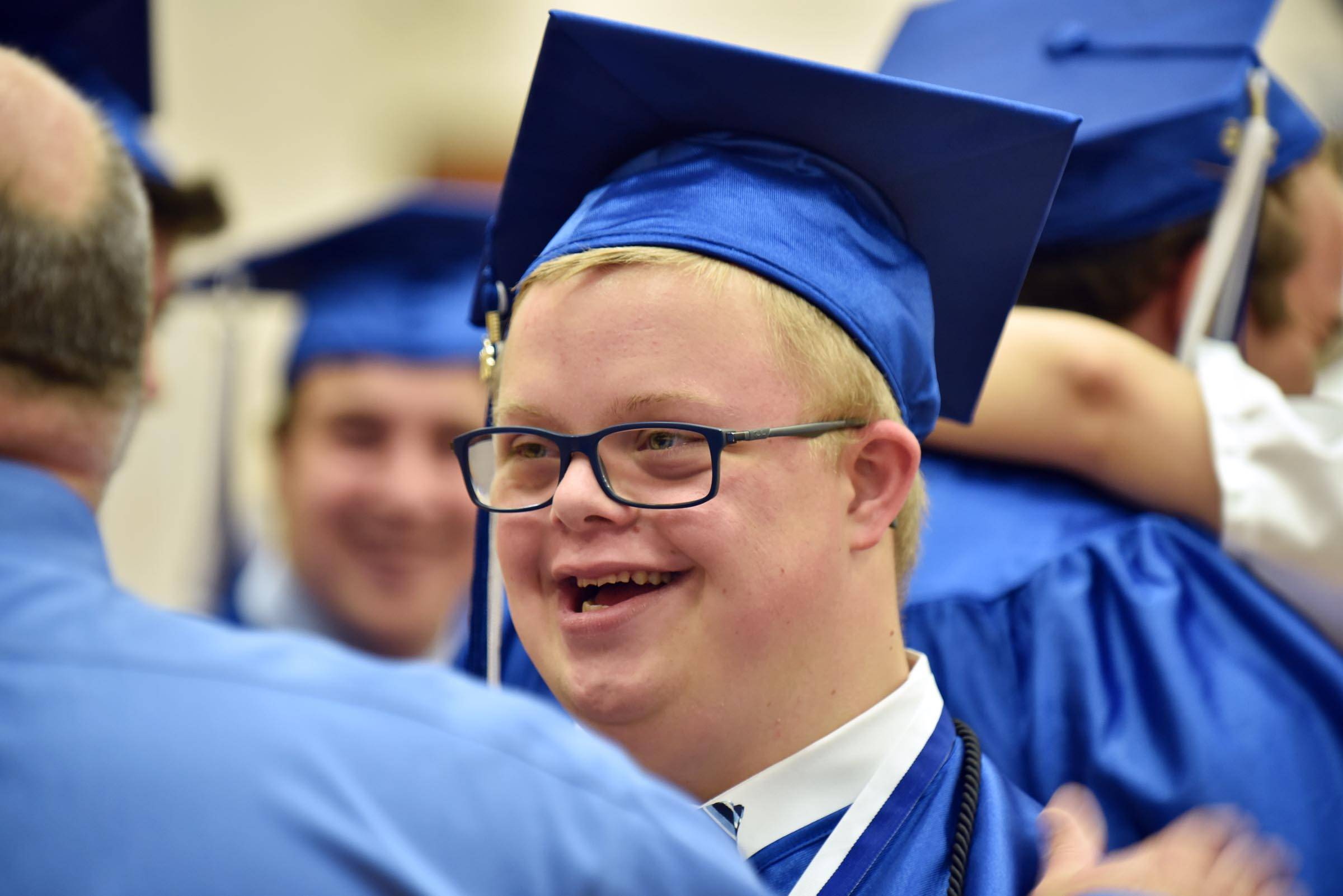 Gradute Nicholas Pesce laughs as he gets ready at Lake Zurich High School graduation Sunday at the school.