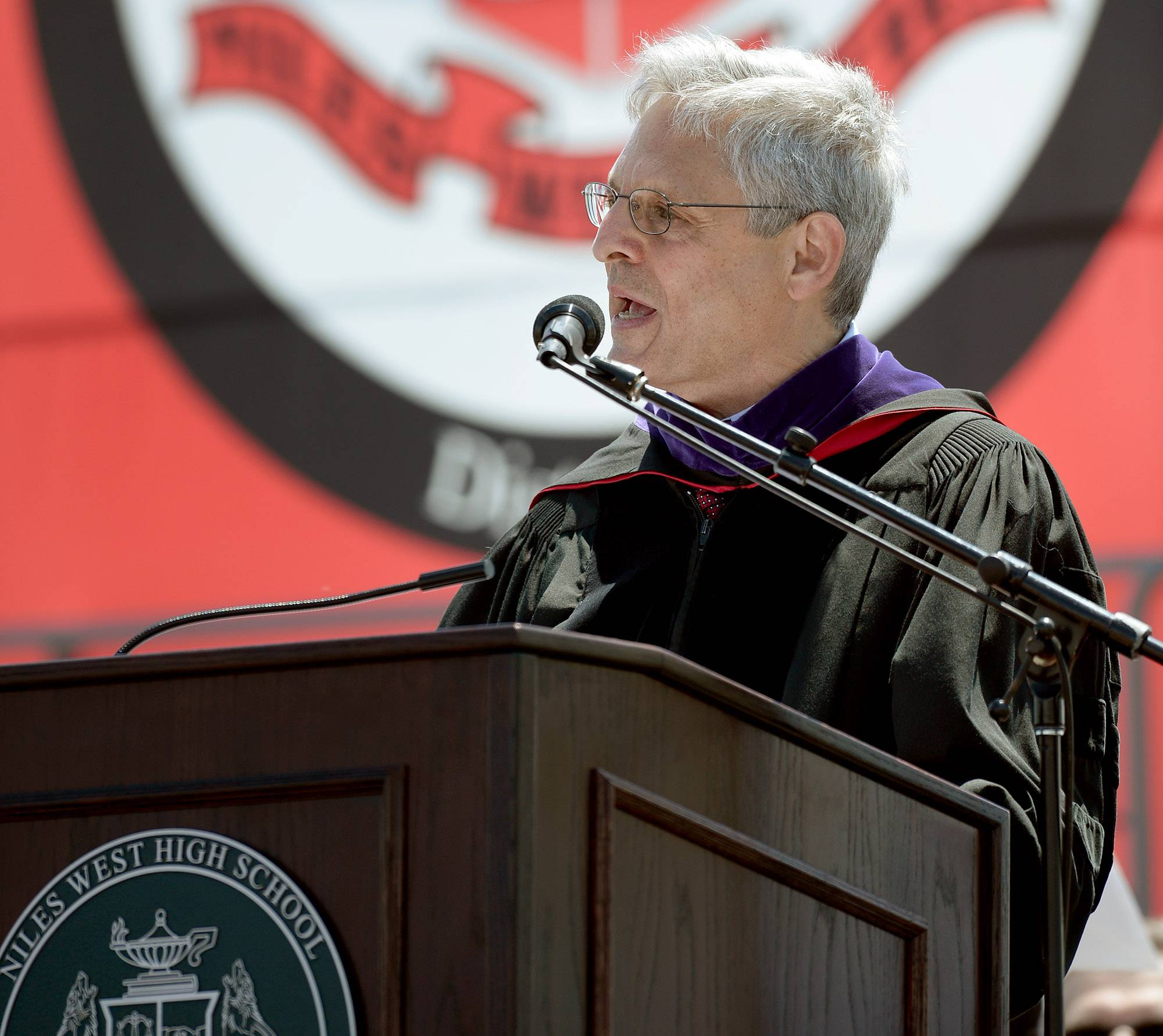 Supreme Court nominee Merrick Garland addresses the graduating seniors at Niles West High School Sunday.