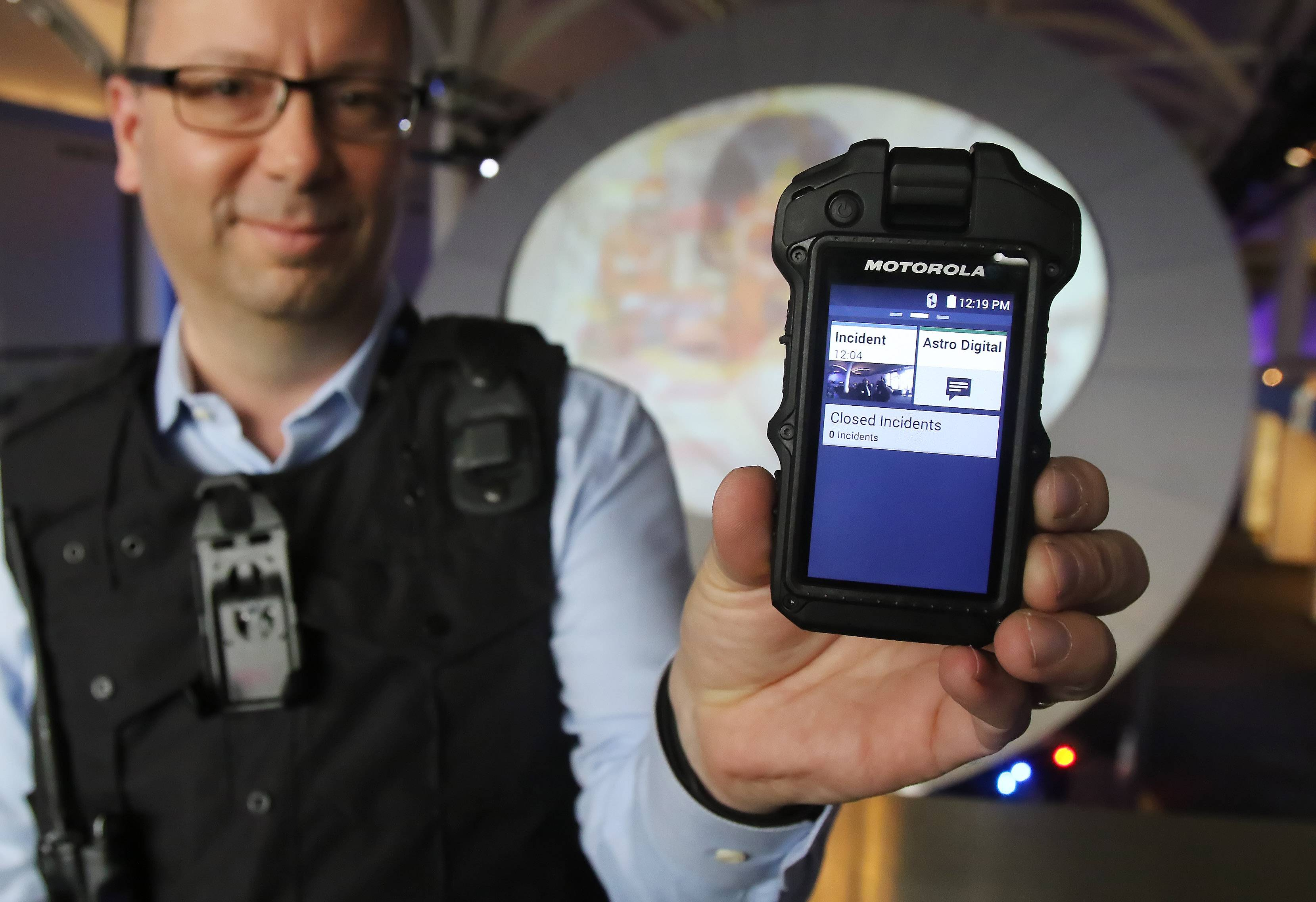 Motorola Solutions Senior Manager Ron Toth shows off the Si500 camera, part of its new generation of policing products.