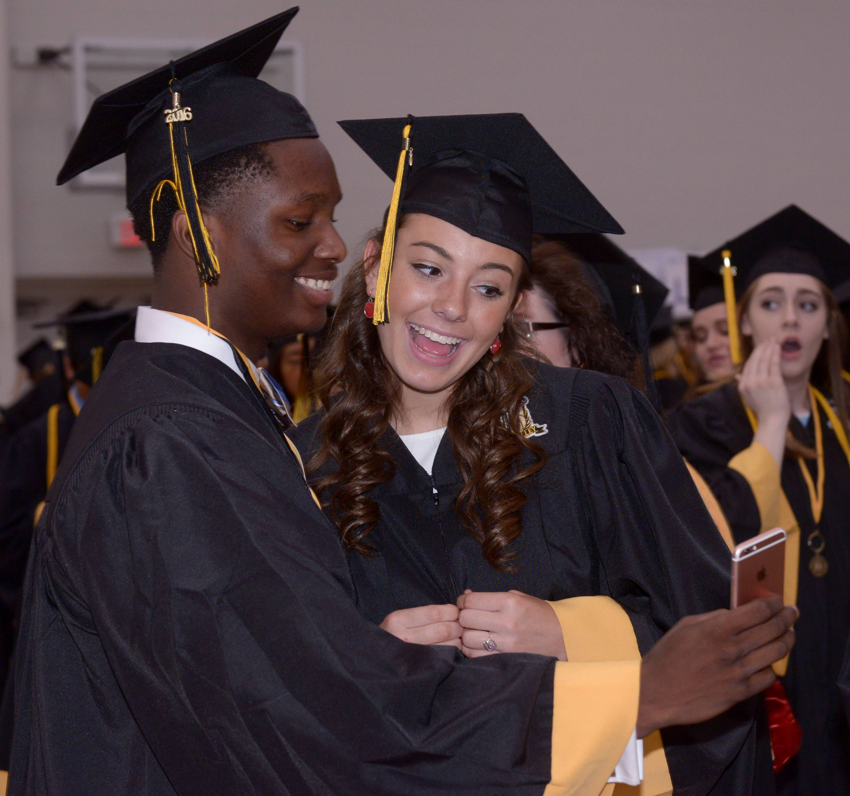 Maurice Burkley and Maci Cotler take a selfie before the start of the Metea Valley High School graduation ceremony at Northern Illinois University in DeKalb on May 29, 2016.