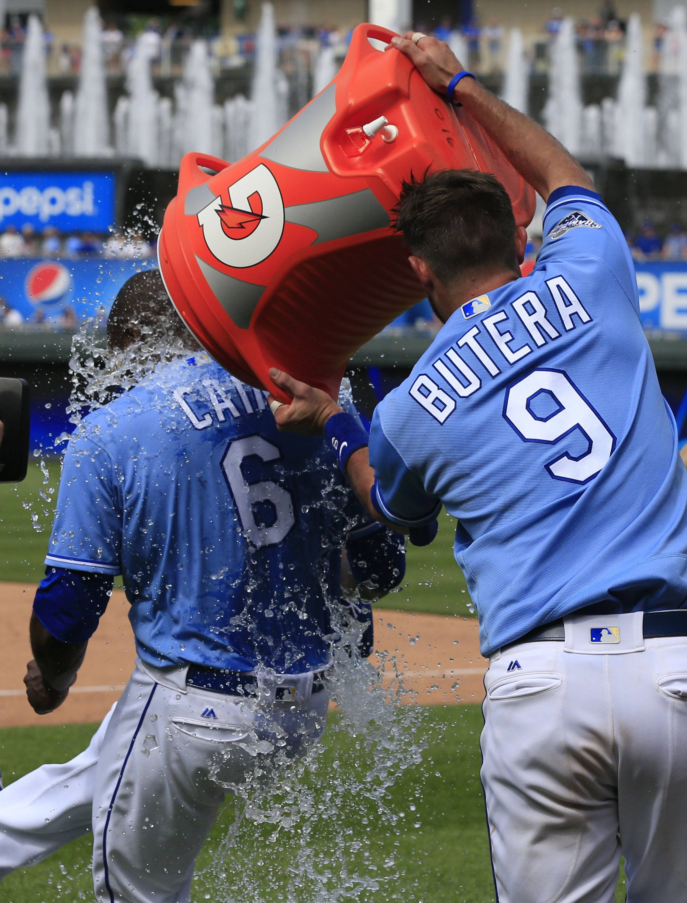 Kansas City Royals' Drew Butera (9) douses teammate Lorenzo Cain (6) following a baseball game against the Chicago White Sox at Kauffman Stadium in Kansas City, Mo., Sunday, May 29, 2016. The Royals defeated the White Sox 5-4.