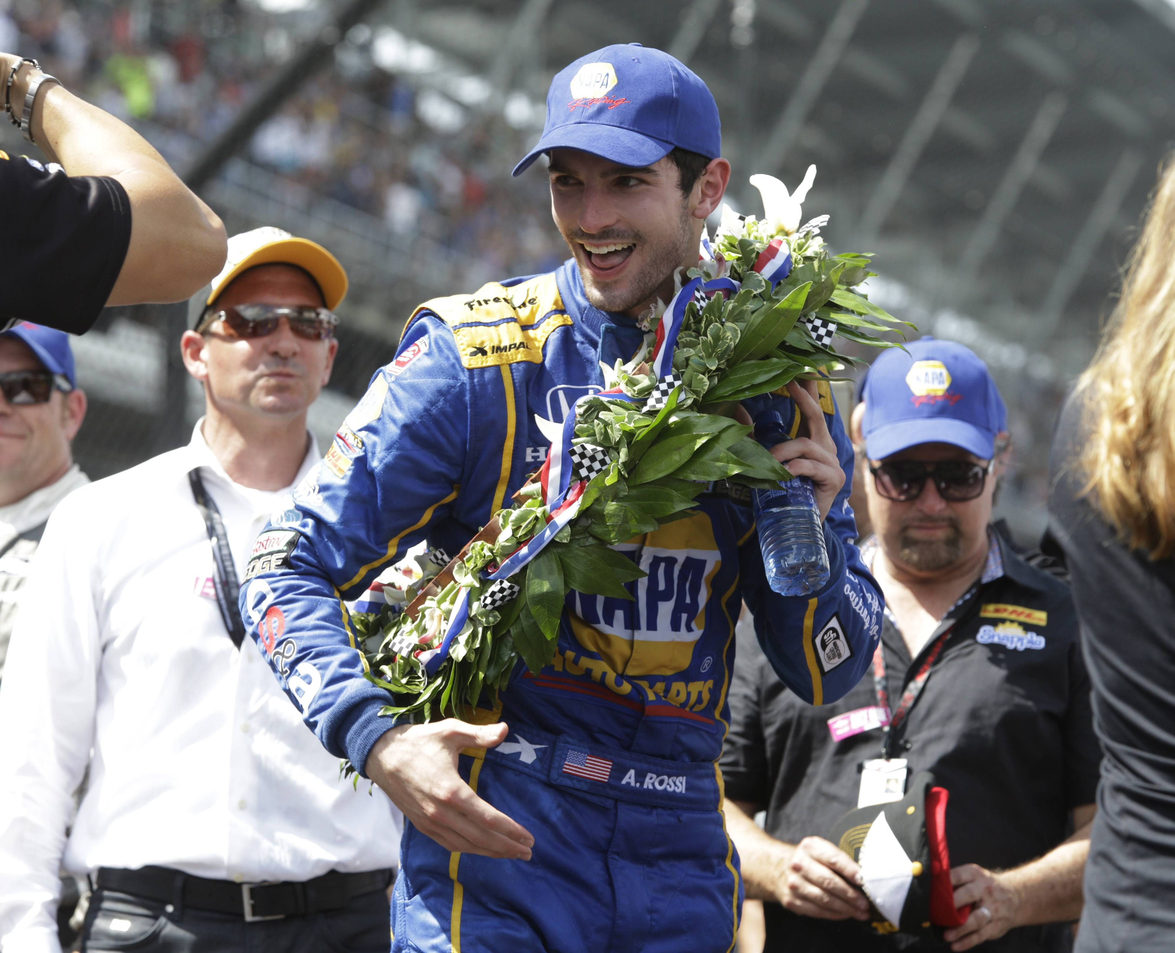 Alexander Rossi smiles after wining the 100th running of the Indianapolis 500 auto race at Indianapolis Motor Speedway in Indianapolis, Sunday, May 29, 2016.