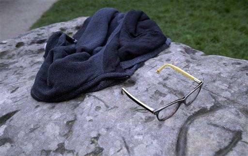 A child's glasses and a jacket lie on a rock in the Park Monceau, after a lightning strike in Paris, Saturday, May 28, 2016. A Paris fire service spokesman says 11 people including eight children have been hit by lightning in a Paris park after a sudden spring storm overtook a child's birthday party. The victims had sought shelter Saturday under a tree at Park Monceau, a popular weekend hangout for well-to-do families in Paris. (AP Photo/Mstyslav Chernov)