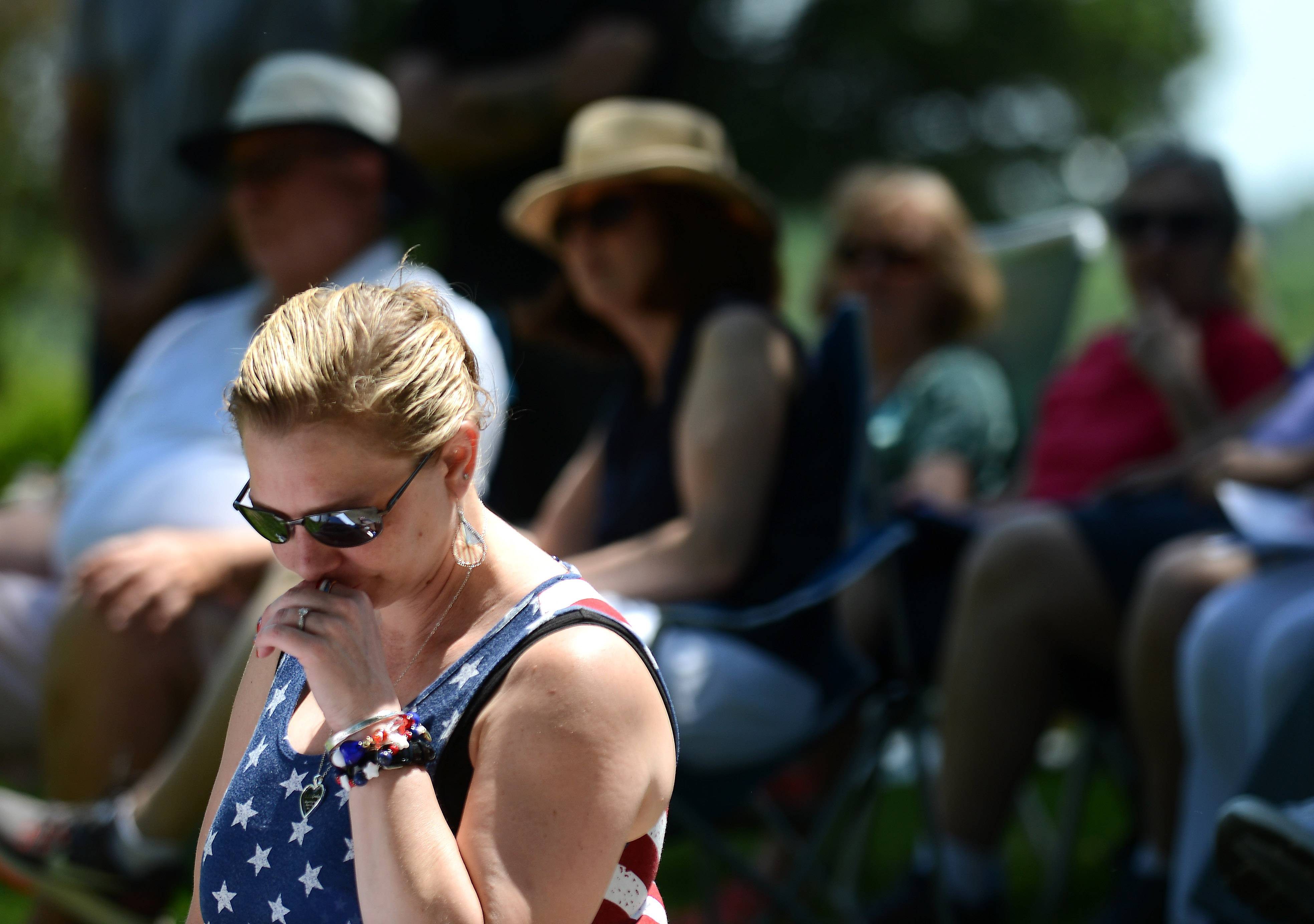 Brenda Terry of Carpentersville gets choked up during the annual West Dundee Memorial Day program at River Valley Memorial Gardens Monday. Her grandfather, a World War II veteran, recently passed and is buried at the cemetery. Her brother is serving in the Army.