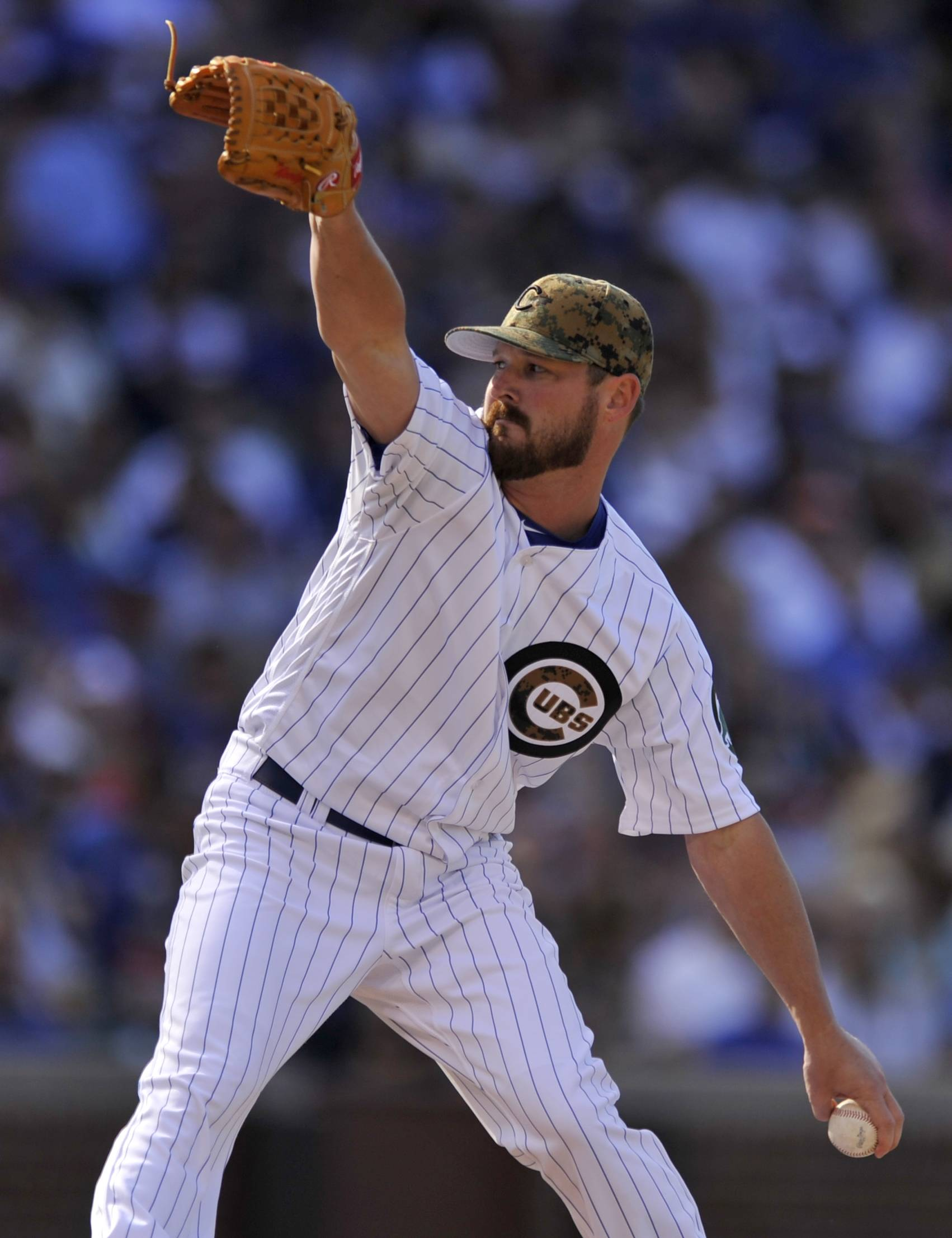 Chicago Cubs relief pitcher Travis Wood delivers a pitch during the third inning of a baseball game against the Los Angeles Dodgers on Monday, May 30, 2016, in Chicago. Chicago won 2-0. (AP Photo/Paul Beaty)