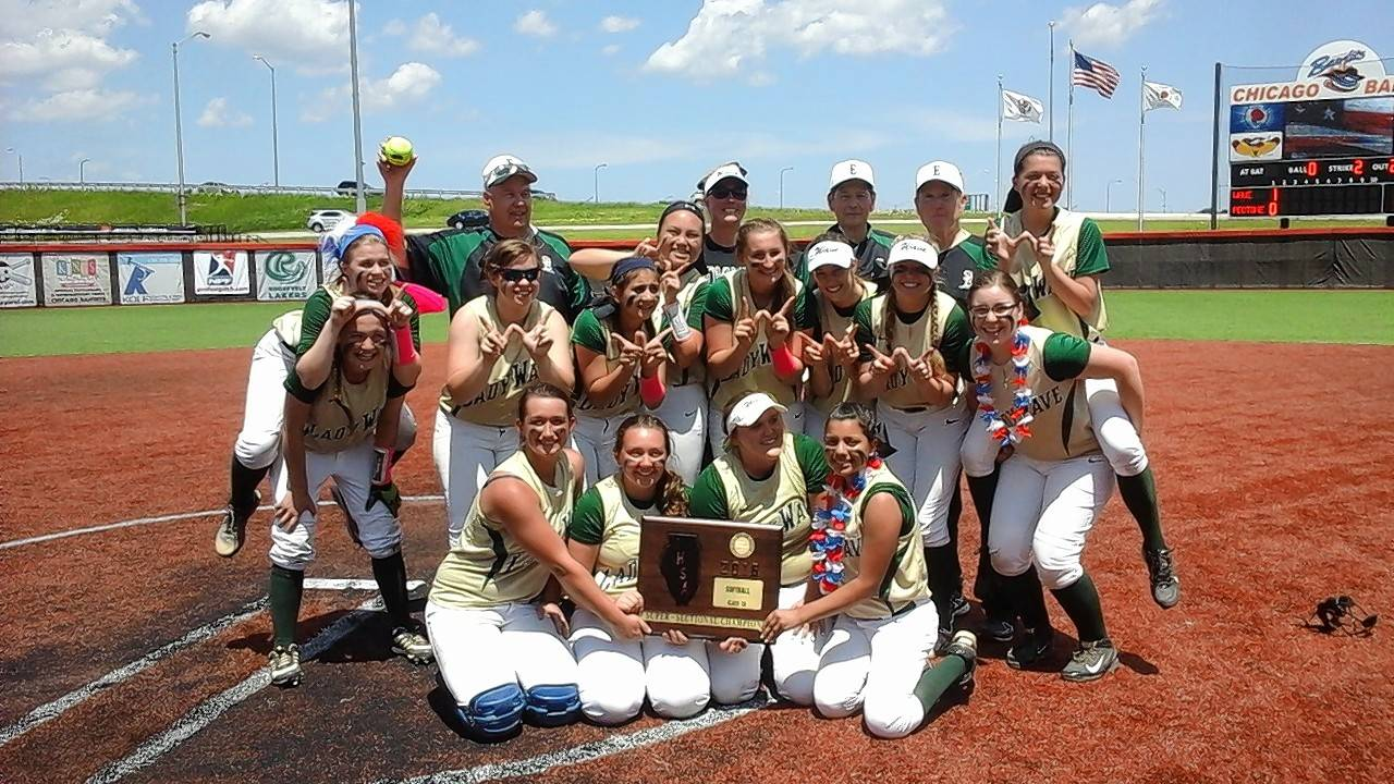 John Radtke/jradtke@dailyherald.com The St. Edward softball team displays its Class 2A supersectional plaque Monday after the Green Wave defeated Peotone 1-0 in 11 innings in the Rosemont supersectional at Bandits Stadium.