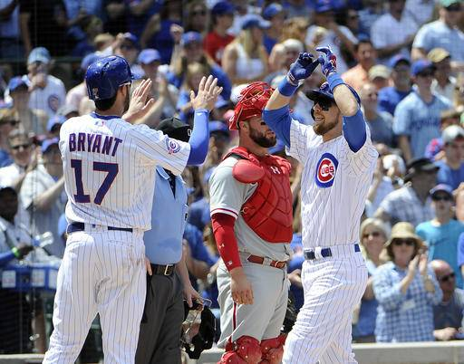 Chicago Cubs' Ben Zobrist, right, is greeted by Kris Bryant (17) after hitting a three-run home run against the Philadelphia Phillies during the third inning of a baseball game, Sunday, May 29, 2016, in Chicago. (AP Photo/David Banks)