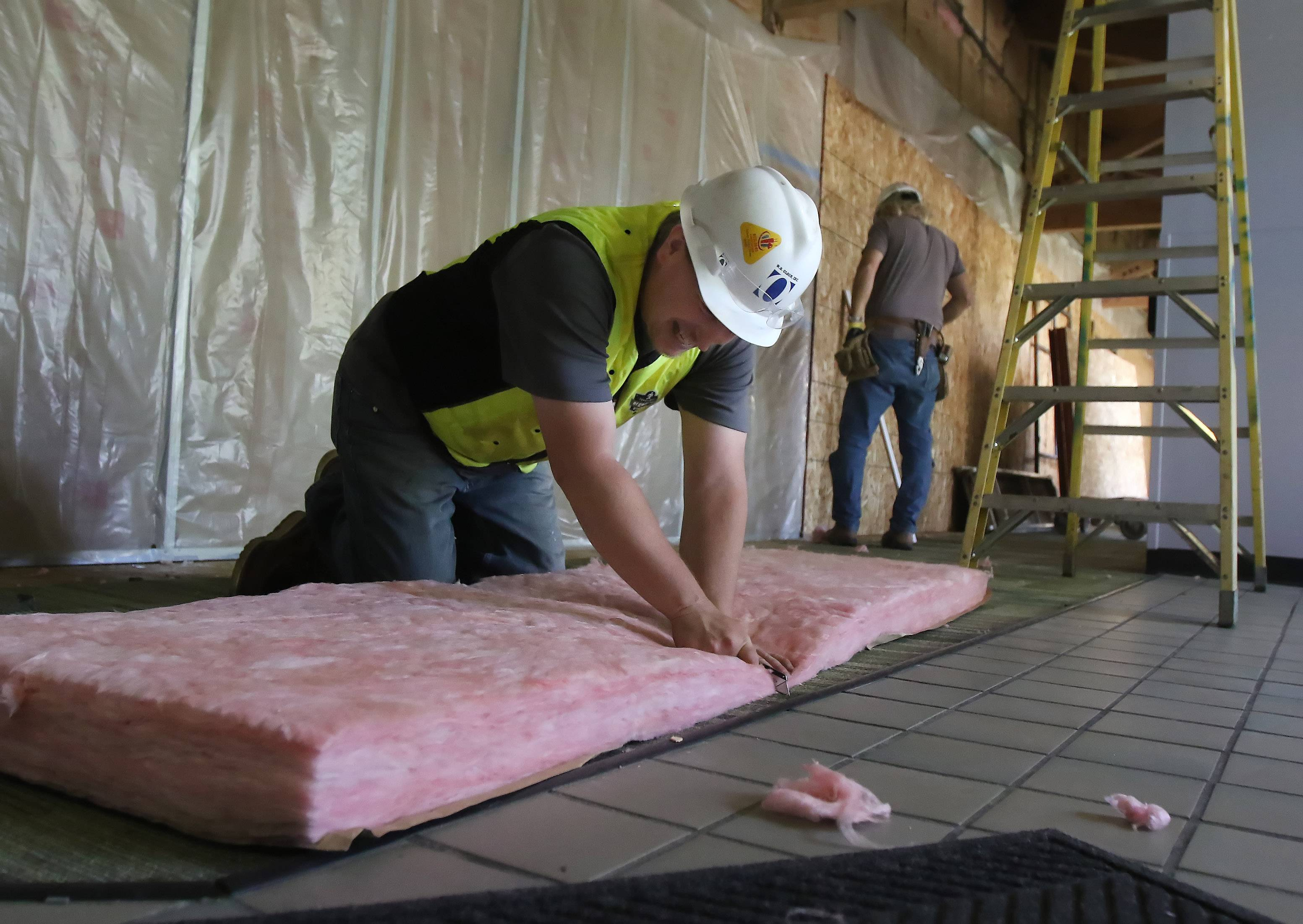 Brian Shumate of W.B. Olson cuts insulation during the construction of additions to the Sullivan Community Center in Vernon Hills. The Vernon Hills Park District is adding another gymnasium, several new children's rooms and an expanded, secure entrance.