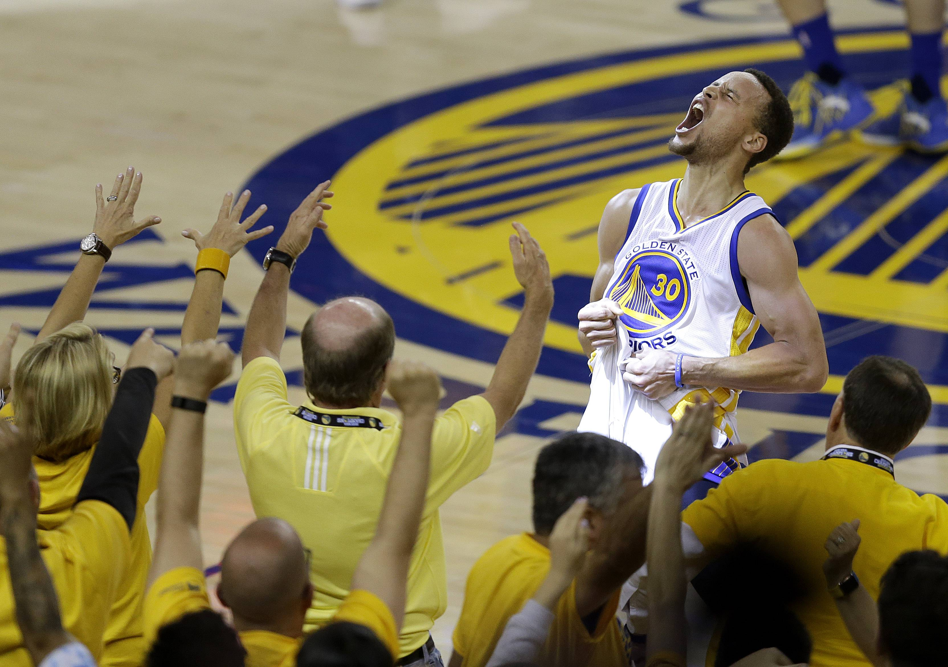 Fans cheer as Golden State Warriors guard Stephen Curry yells after the Warriors beat the Oklahoma City Thunder in Game 7 of the NBA basketball Western Conference finals in Oakland, Calif., Monday, May 30, 2016. The Warriors won 96-88. (AP Photo/Ben Margot)