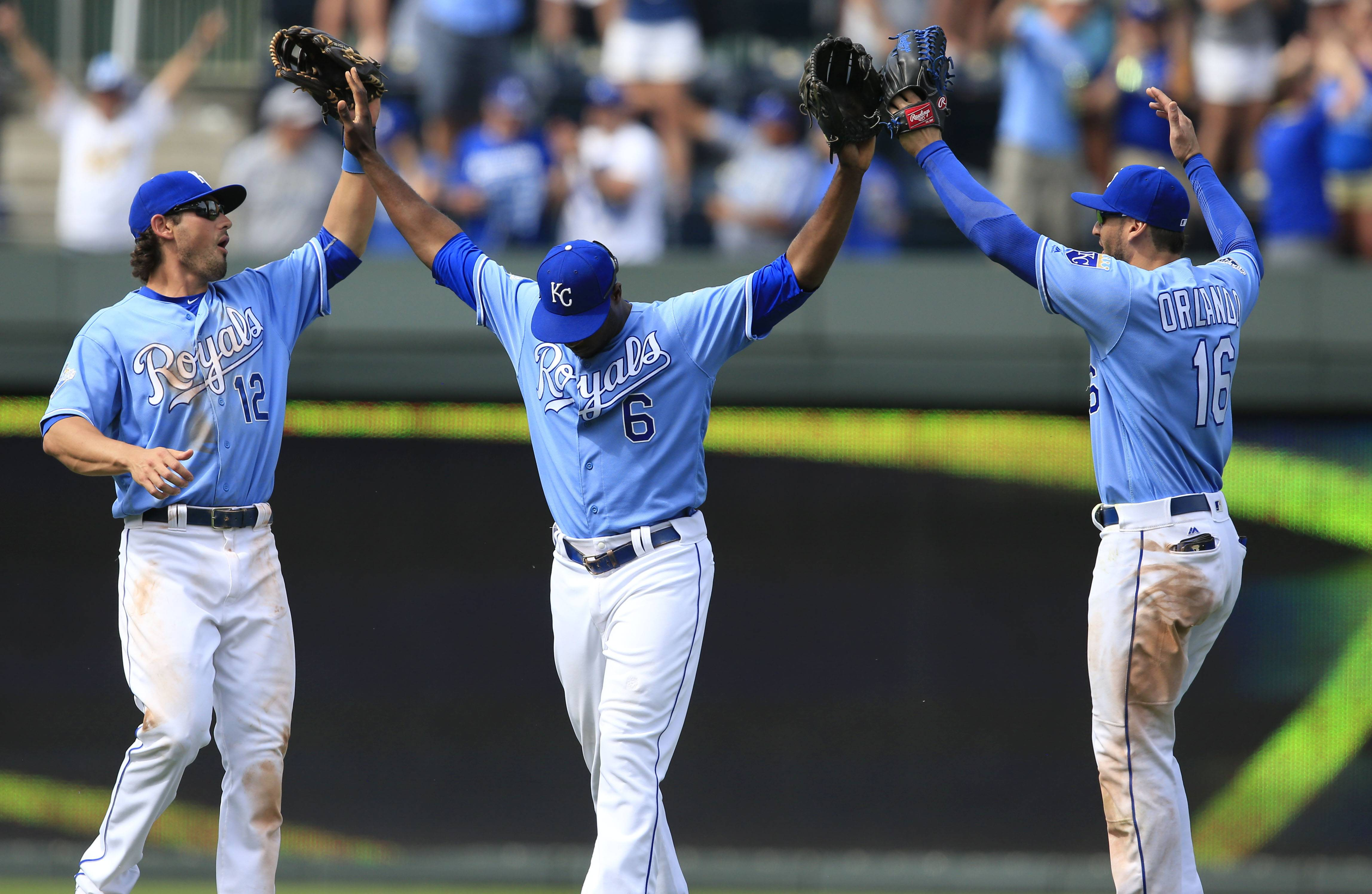 Kansas City Royals center fielder Lorenzo Cain (6) celebrates with fellow outfielders Brett Eibner (12) and Paulo Orlando (16) following a baseball game against the Chicago White Sox at Kauffman Stadium in Kansas City, Mo., Sunday, May 29, 2016. The Royals defeated the White Sox 5-4. (AP Photo/Orlin Wagner)