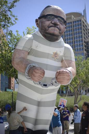 Protesters display a giant balloon caricature of Arizona Sheriff Joe Arpaio outside the federal courthouse in Phoenix, Ariz. on Tuesday, May 31, 2016. Arpaio is appearing before a federal judge to examine ways to address the Maricopa County sheriff's contempt-of-court violations in a racial profiling case. Arpaio was found in civil contempt two weeks ago for disobeying court orders in the profiling case, including letting his immigration patrols continue after the judge ordered them stopped.