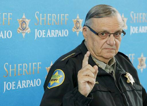 FILE - In this Dec. 18, 2013, file photo, Maricopa County Sheriff Joe Arpaio speaks at a news conference at the Sheriff's headquarters in Phoenix. A federal judge will hold a hearing Tuesday, May 31, 2016, to examine ways to address the Maricopa County sheriff's contempt-of-court violations in a racial profiling case. Arpaio was found in civil contempt two weeks ago for disobeying court orders in the profiling case, including letting his immigration patrols continue after the judge ordered them stopped.