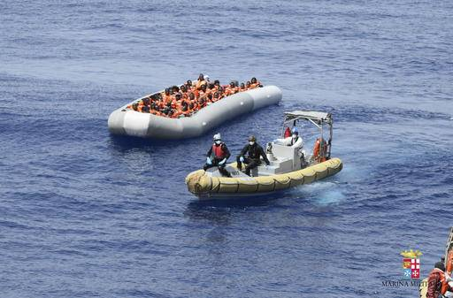 This undated image made available Monday, May 30, 2016 by the Italian Navy Marina Militare shows migrants being rescued at sea. Survivor accounts have pushed to more than 700 the number of migrants feared dead in Mediterranean Sea shipwrecks over three days in the past week, even as rescue ships saved thousands of others in daring operations. (Italian Navy via AP)