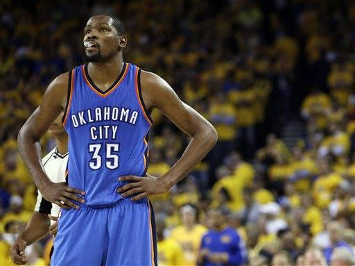 FILE - In this May 26, 2016, file photo, Oklahoma City Thunder's Kevin Durant watches during the closing minutes of the second half in Game 5 of the NBA basketball Western Conference finals against the Golden State Warriors in Oakland, Calif. Durant may not be ready to talk about his free agency yet, but it's one of the biggest issues facing the Oklahoma City Thunder after losing in seven games of the Western Conference finals to Golden State. (AP Photo/Marcio Jose Sanchez, File)