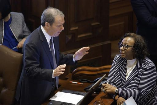 Illinois Senate President John Cullerton, D-Chicago, left, talks to Illinois Sen. Mattie Hunter, D-Chicago, right, while on the Senate floor during session at the Illinois State Capitol Tuesday, May 31, 2016, in Springfield, Ill., as lawmakers press ahead on the last day of the spring legislative session.