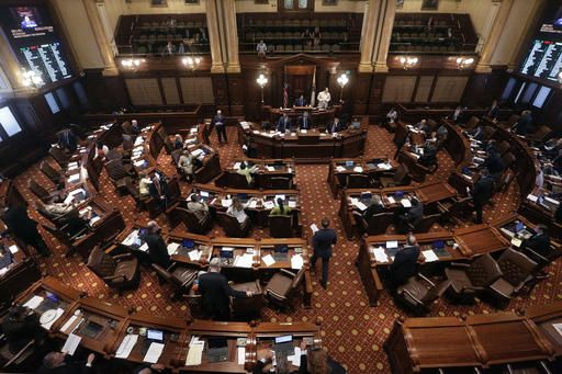 Illinois senators debate legislation while on the Senate floor during session at the Illinois State Capitol Tuesday, May 31, 2016, in Springfield, Ill., as lawmakers press ahead on the last day of the spring legislative session.