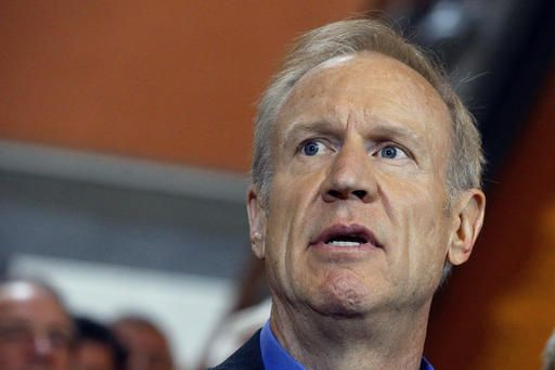 In this Tuesday, May 31, 2016 photo, Illinois Gov. Bruce Rauner speaks to reporters outside his office at the Illinois State Capitol in Springfield, Ill. After finishing another legislative session without agreeing on a budget, Rauner and Illinois' ruling Democrats left the state Capitol Tuesday looking to November when they'll try to convince voters the other side is to blame for the state's enormous fiscal mess. But there's huge political risk for both sides leading up to the general election.