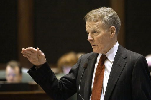 In this Tuesday, May 17, 2016 photo, Illinois Speaker of the House Michael Madigan, D-Chicago, speaks to lawmakers while on the House floor during session at the Illinois State Capitol in Springfield, Ill. After finishing another legislative session without agreeing on a budget, Gov. Bruce Rauner and Illinois' ruling Democrats left a chaotic night on Tuesday, May 31,  looking to November when they'll try to convince voters the other side is to blame for the state's enormous fiscal mess. But there's huge political risk for both sides leading up to the general election.