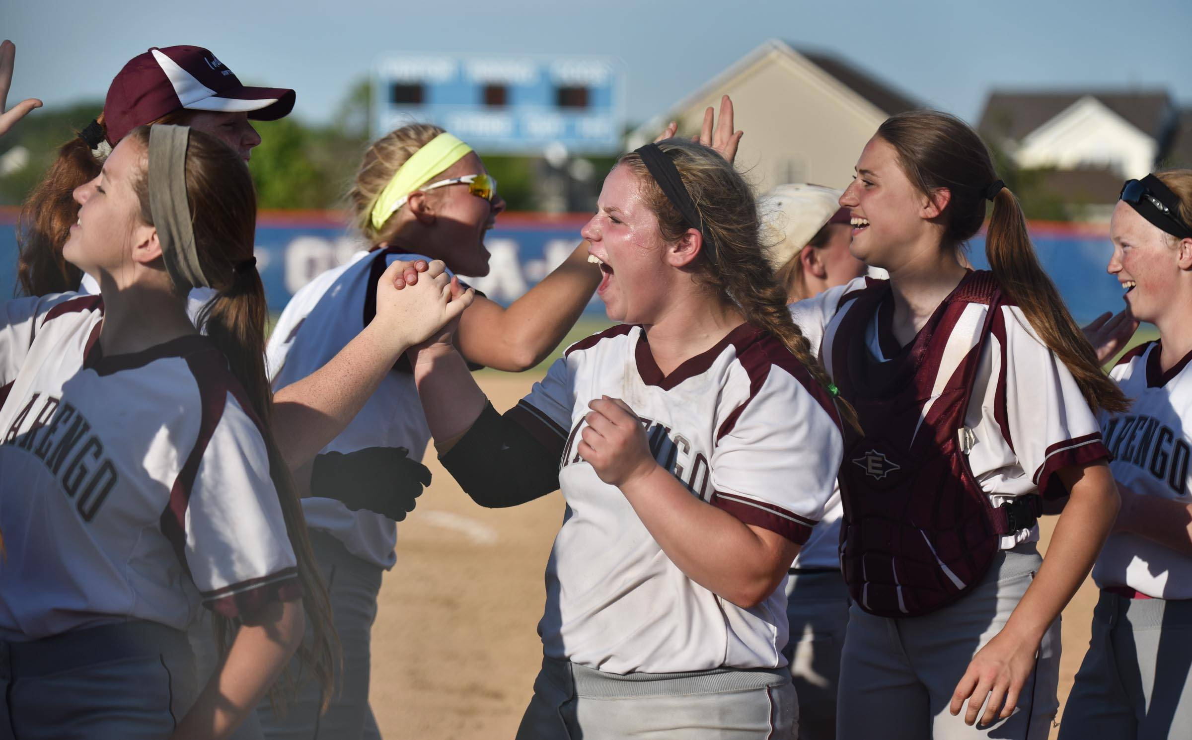 Marengo pitcher Mariah Dionne celebrates the win against Burlington Central Wednesday in the Genoa-Kingston sectional game.