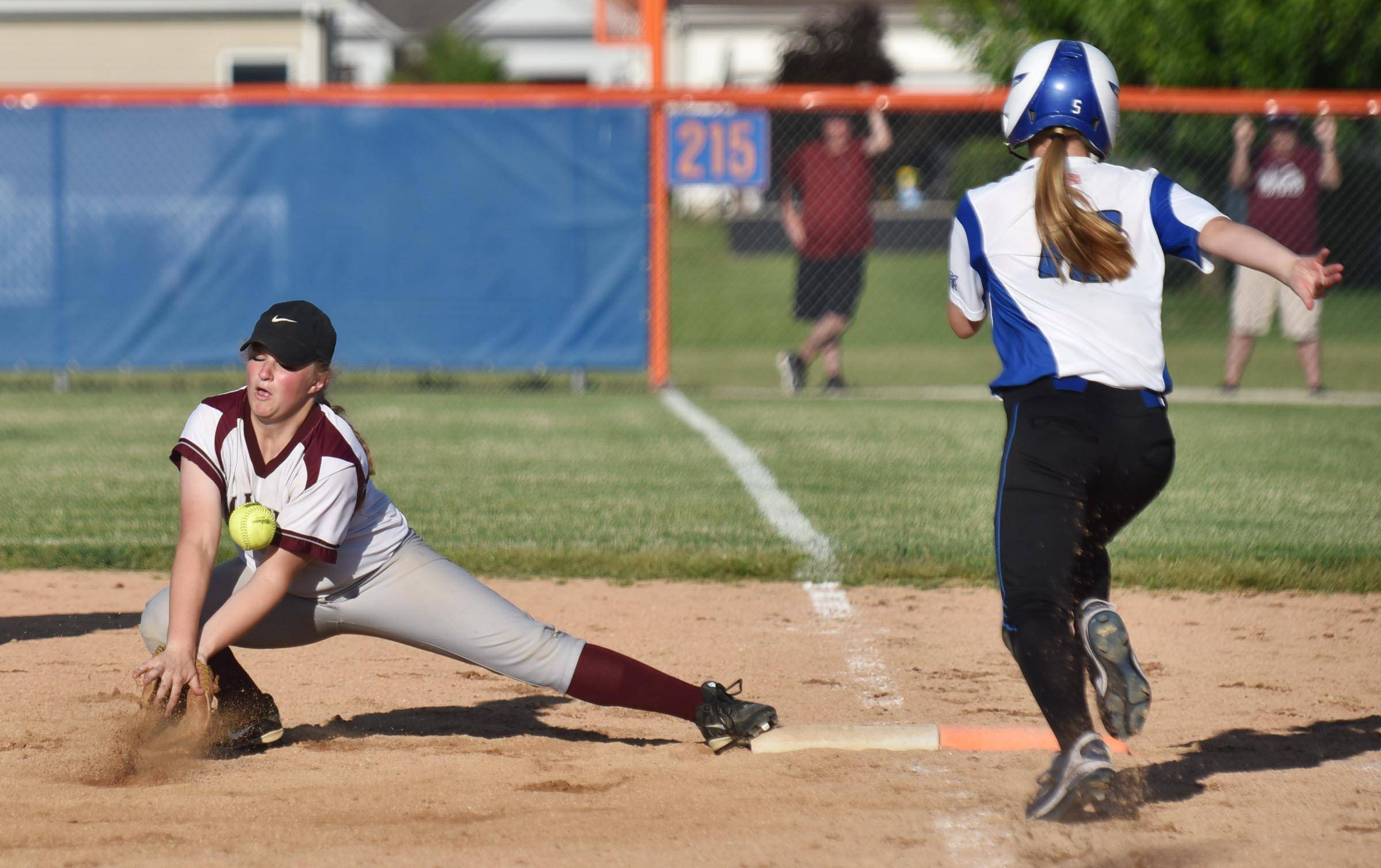 Burlington Central's Sarah Kinney is safe in the bottom of the 10th inning as Marengo's Anna Walsweer is unable to handle a low throw Wednesday in the Genoa-Kingston sectional game. Kinney was stranded on base as Marengo won 1-0.