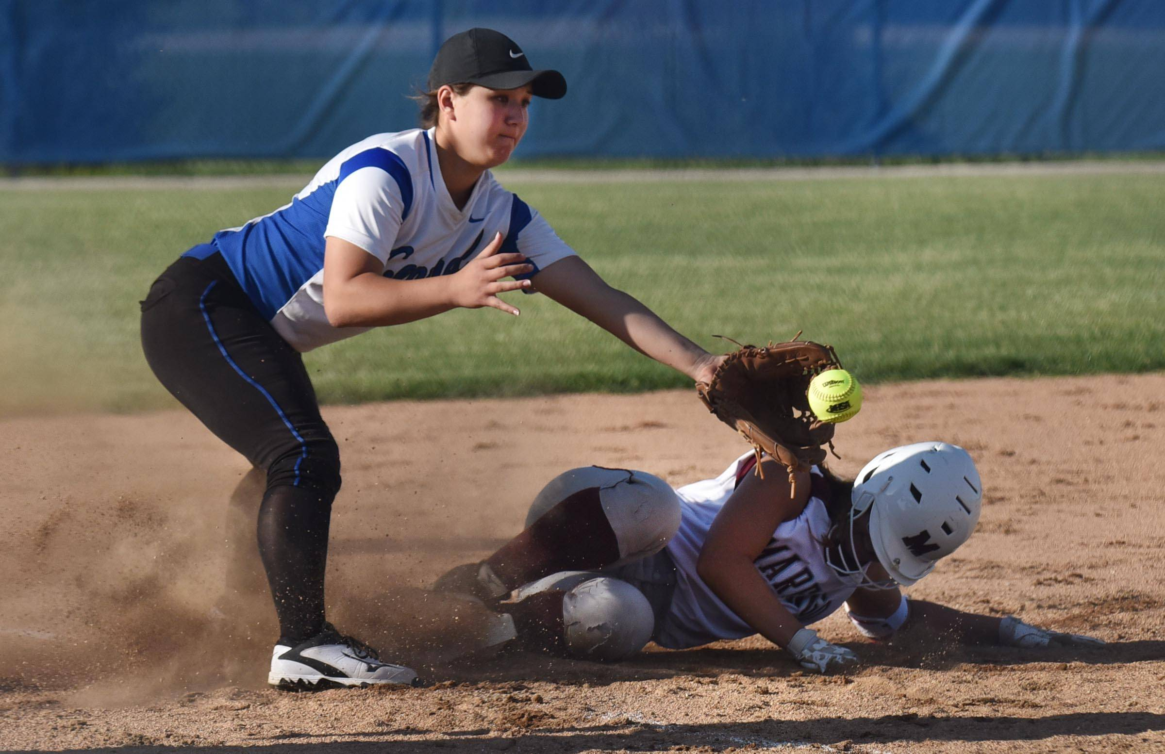 Burlington Central's Kristina Ahlers reaches for the ball to tag Marengo's Susannah Nawrot Wednesday in the Genoa-Kingston sectional game. Nawrot was safe at third and then scored the only run of the game.