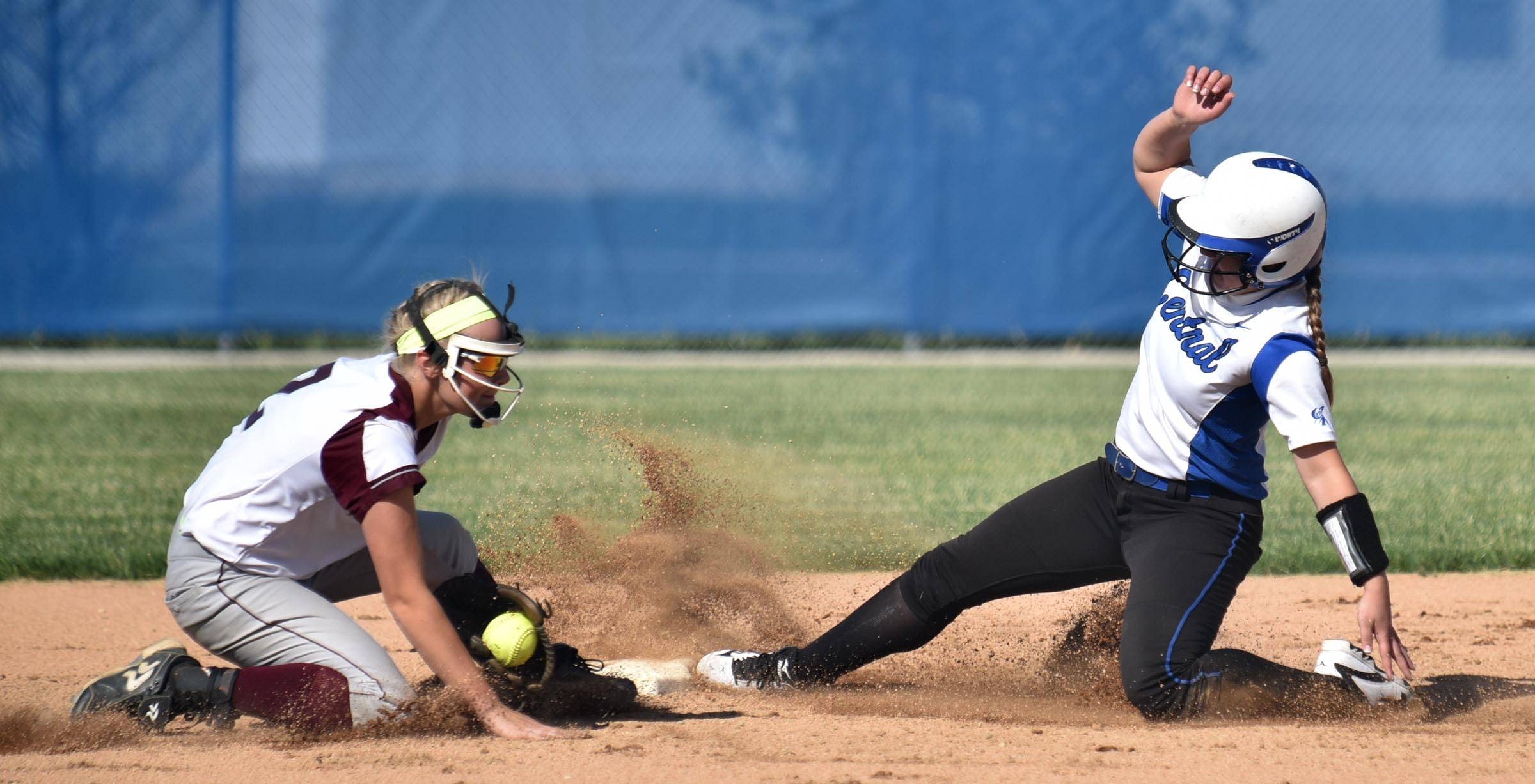 Burlington Central's Kristina Ahlers slides safely into second base as Marengo's Leah Secor tries to secure the ball early in the game Wednesday in the Genoa-Kingston sectional.
