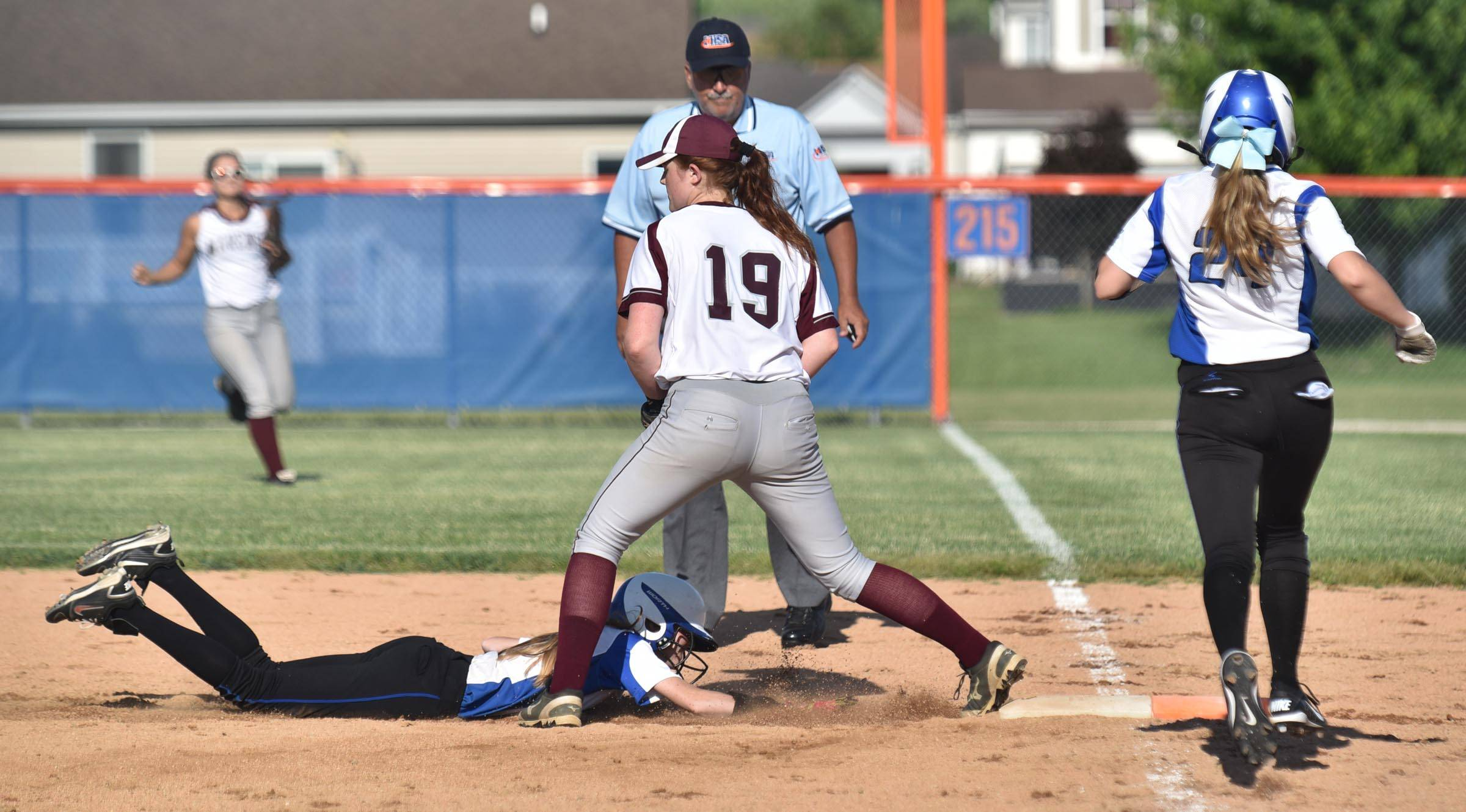 Burlington Central's Kassie Kramer is forced out as she dives back to first base after being caught too far off the bag on a line drive out by teammate Emily Kisch as Marengo's Megan Anthony secures the ball in the sixth inning Wednesday in the Genoa-Kingston sectional game.