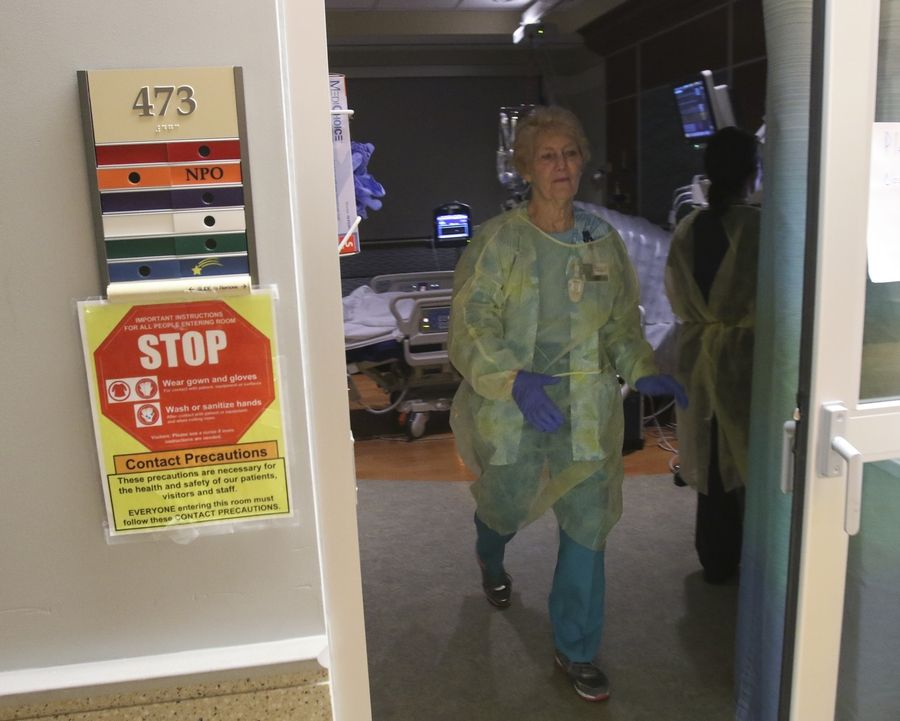 Merrilee Andelbradt, R.N., leaves a patient's room at Edward Hospital in Naperville. Helping patients is one of the most rewarding aspects of her job, she says.