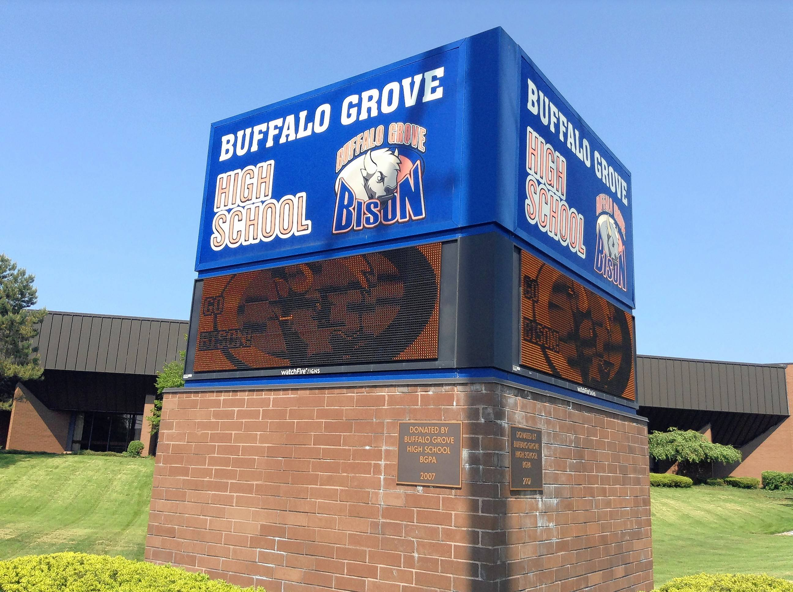 A digital monolith outside Buffalo Grove High School shares school news and messages with passers-by.