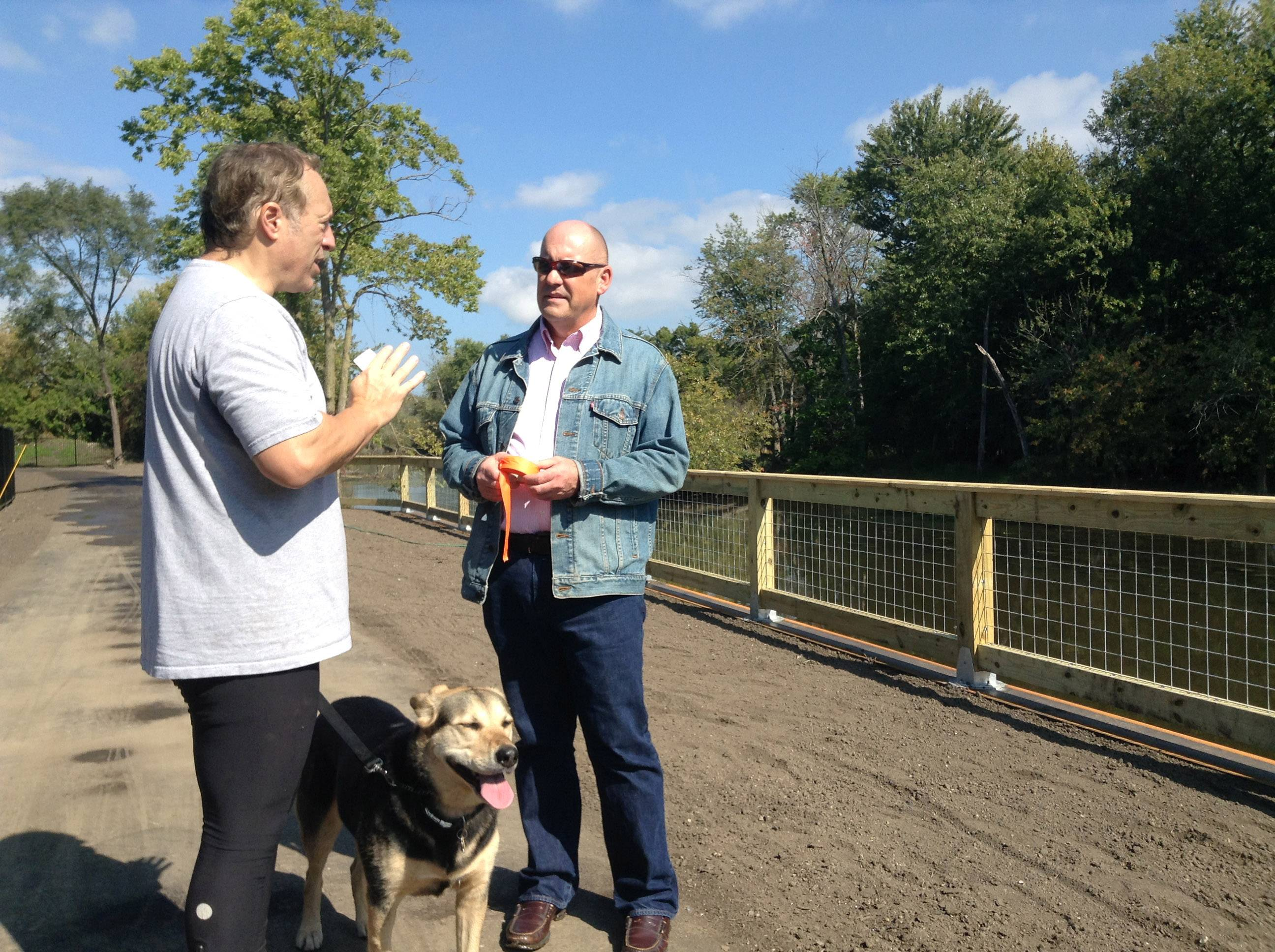 Randy Seebach, right, director of planning and land preservation for the Lake County Forest Preserve District, chats with Bob Friend of Riverwoods along the last link of the Des Plaines River Trail that opened last fall. The forest district tried for 20 years to acquire the land for it.