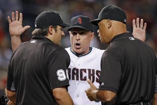 Arizona Diamondbacks manager Chip Hale, middle, argues with umpires Mark Ripperger, left, and Kerwin Danley before Hale was thrown out of the game for arguing a called third strike during the fourth inning of the team's baseball game against the Tampa Bay Rays on Tuesday, June 7, 2016, in Phoenix.