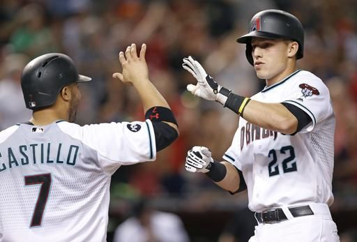 Arizona Diamondbacks' Jake Lamb (22) celebrates his three-run home run against the Tampa Bay Rays with Welington Castillo (7) during the fourth inning of a baseball game Tuesday, June 7, 2016, in Phoenix.