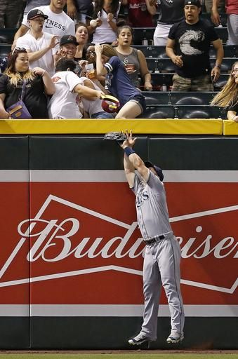 Tampa Bay Rays' Corey Dickerson jumps in vain for three-run home run by Arizona Diamondbacks' Jake Lamb during the fourth inning of a baseball game Tuesday, June 7, 2016, in Phoenix.
