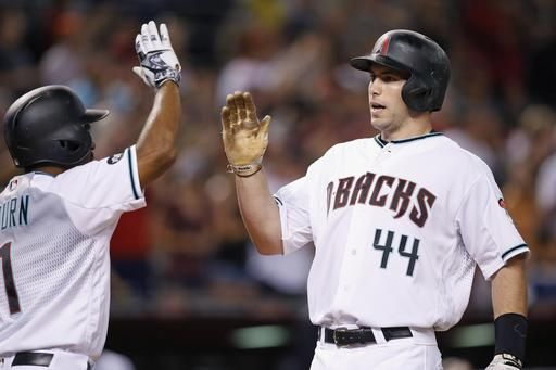 Arizona Diamondbacks' Paul Goldschmidt (44) celebrates his two-run home run against the Tampa Bay Rays with Michael Bourn (1) during the sixth inning of a baseball game Tuesday, June 7, 2016, in Phoenix.