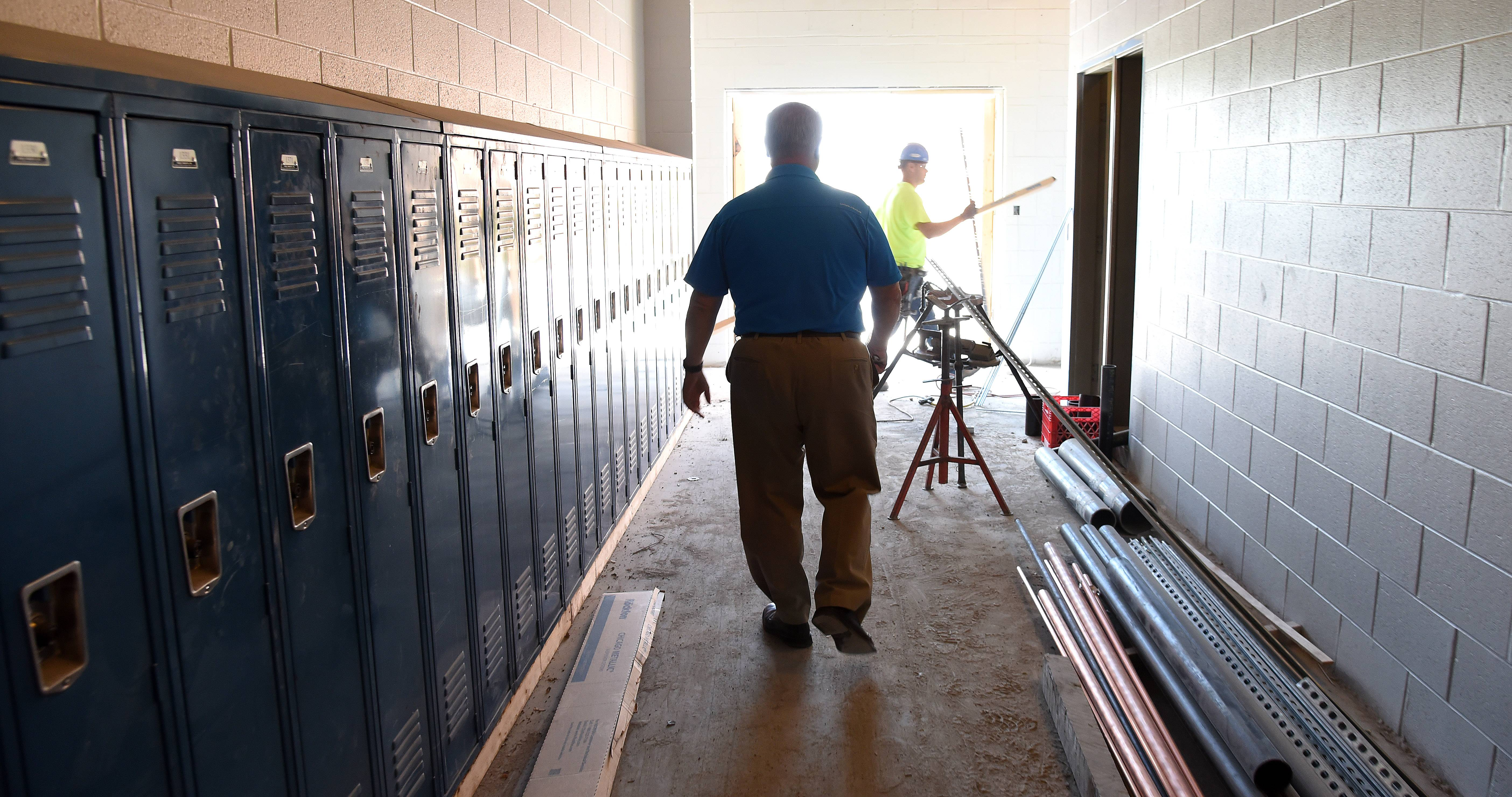 Community Unit District 300 assistant superintendent of operations Chuck Bumbales shows off the work being done at Carpentersville Middle School Wednesday. The school will accommodate sixth-graders from Lakewood Elementary this fall as a result of boundary changes.