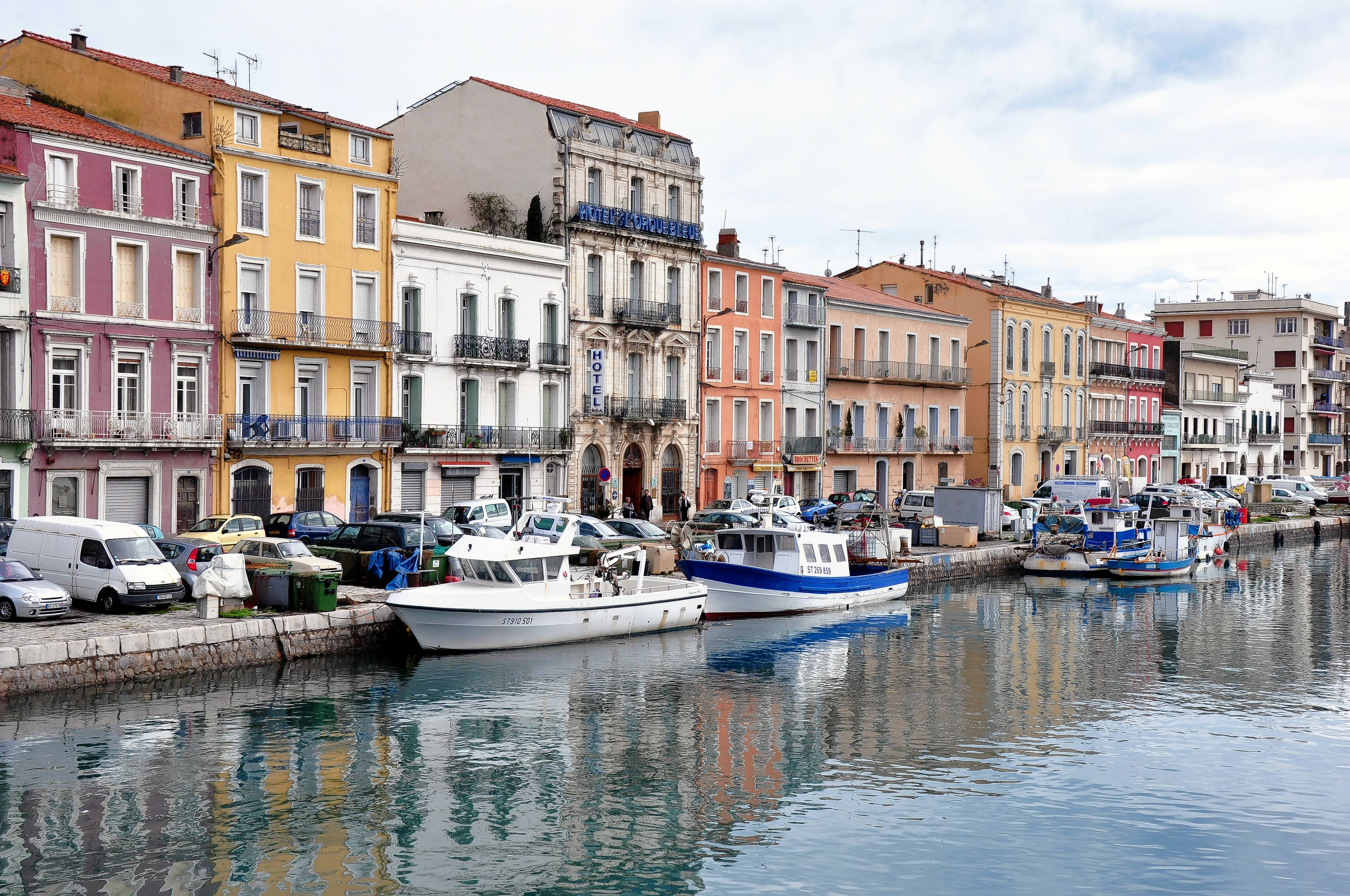 Sète is the biggest fishing port on the French Mediterranean. The business district is crisscrossed by canals lined with shops, hotels and restaurants in pastel-colored buildings.