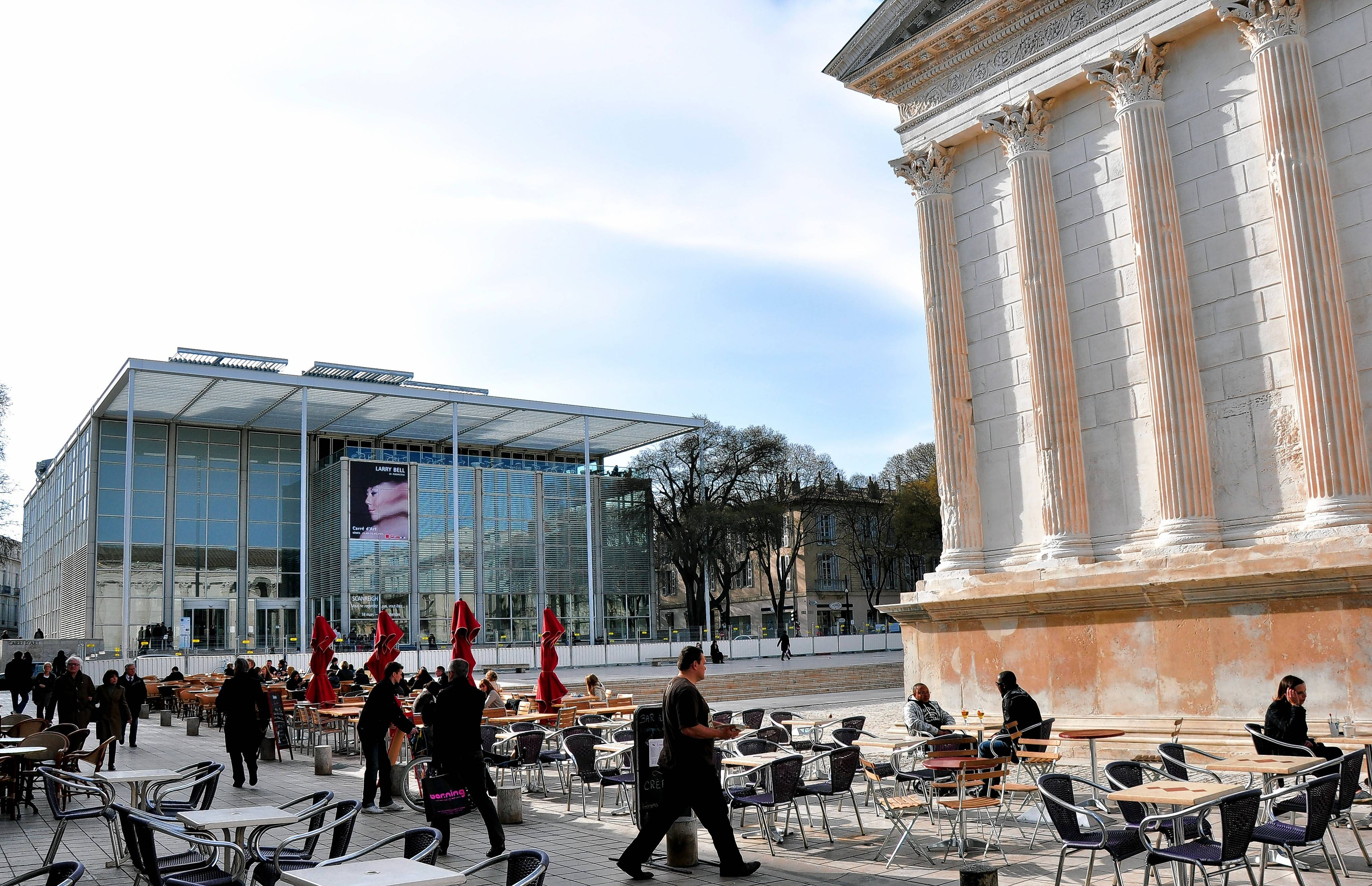 In Nîmes, the architecture of Carré d'Art is a modern interpretation of the 1st century Roman temple in the square opposite it.