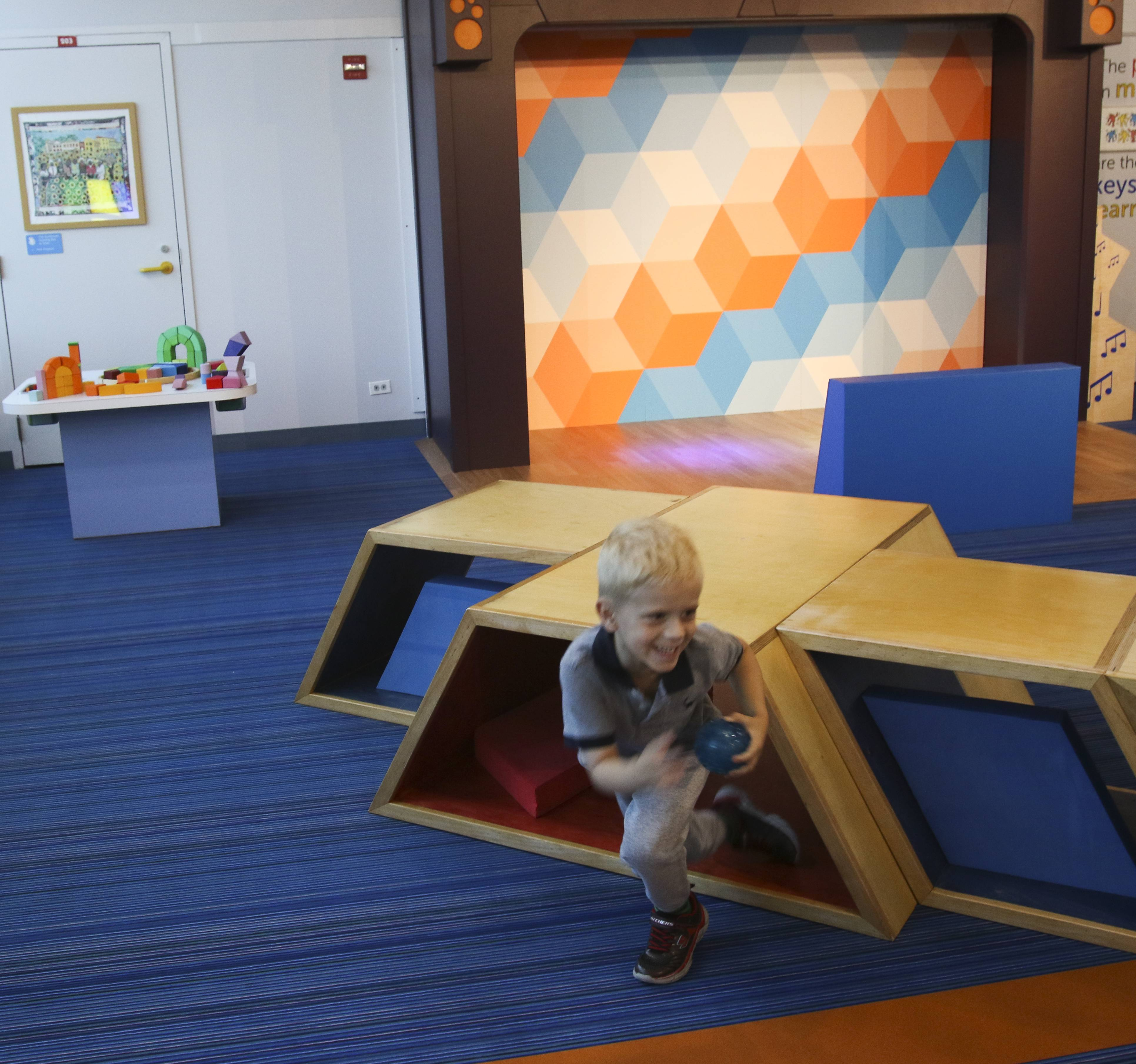 Landon Rozalowsky, 5, checks out a new exhibit called Math+Motion at the DuPage Children's Museum in Naperville.