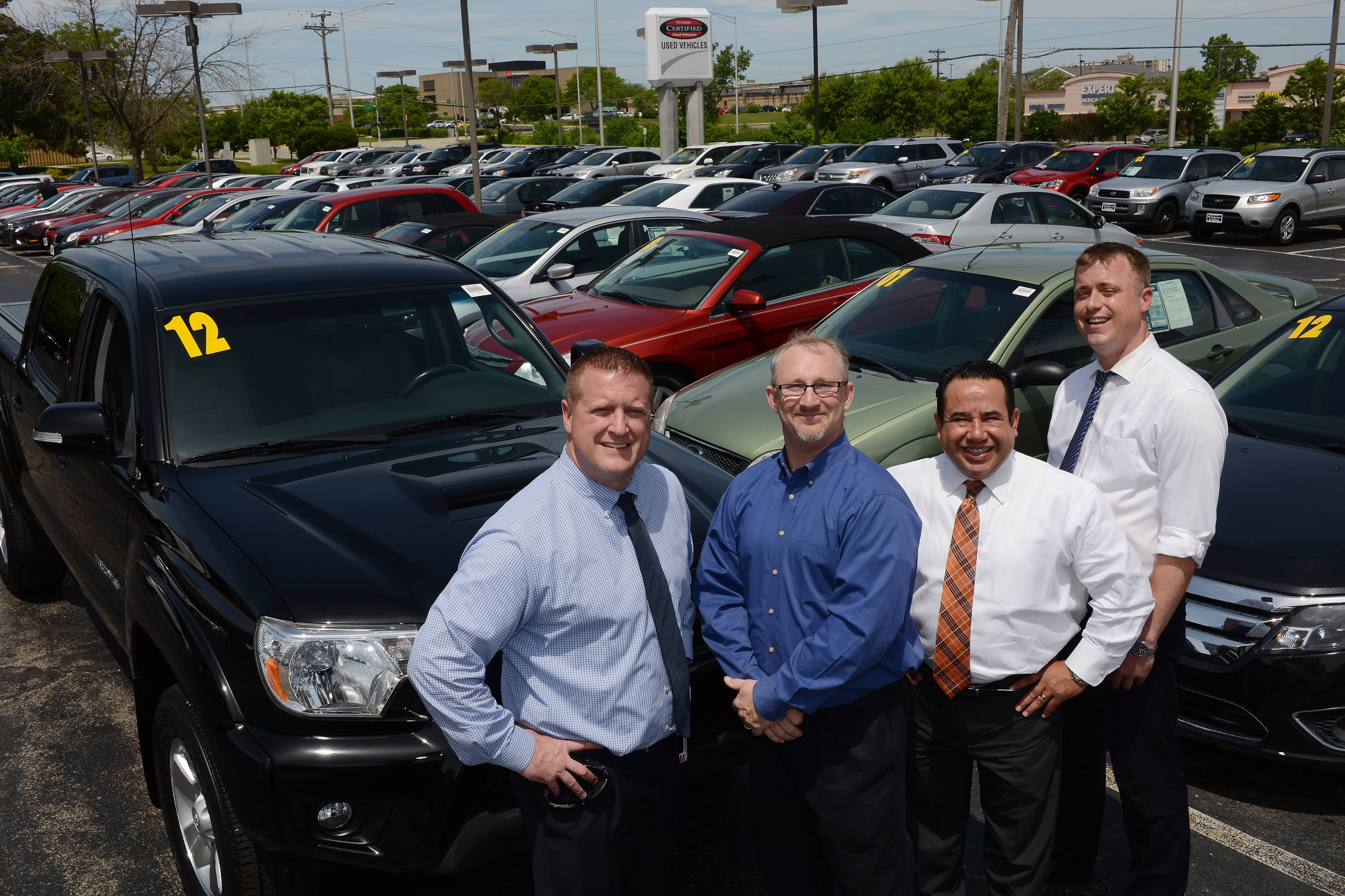 General sales manager Joe Shoemaker, from left, general manager Chris Haley, director of financial services Luis Santibanez and sales manager Jonathan Evensen, all of the Resnick Auto Group, have been getting ready for the Giant Tent Event tent sale at Schaumburg's Woodfield Mall.